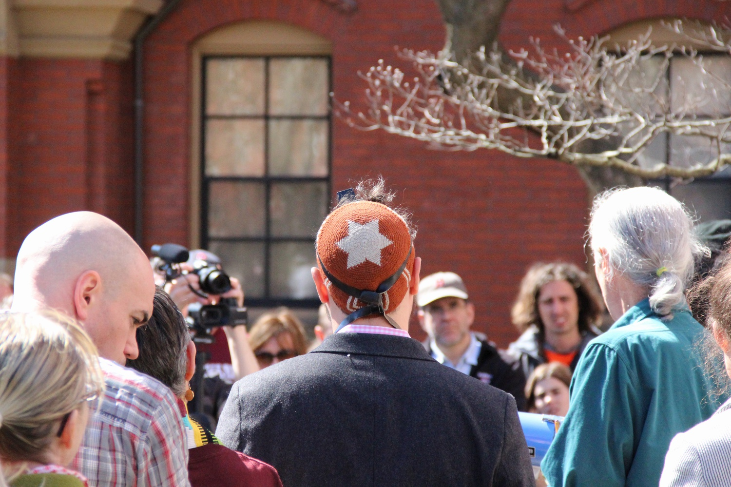 """Protesters attend a """"Faith Day"""" rally in front of Massachusetts Hall. The event was held on Wednesday morning as part of """"Harvard Heat Week."""""""
