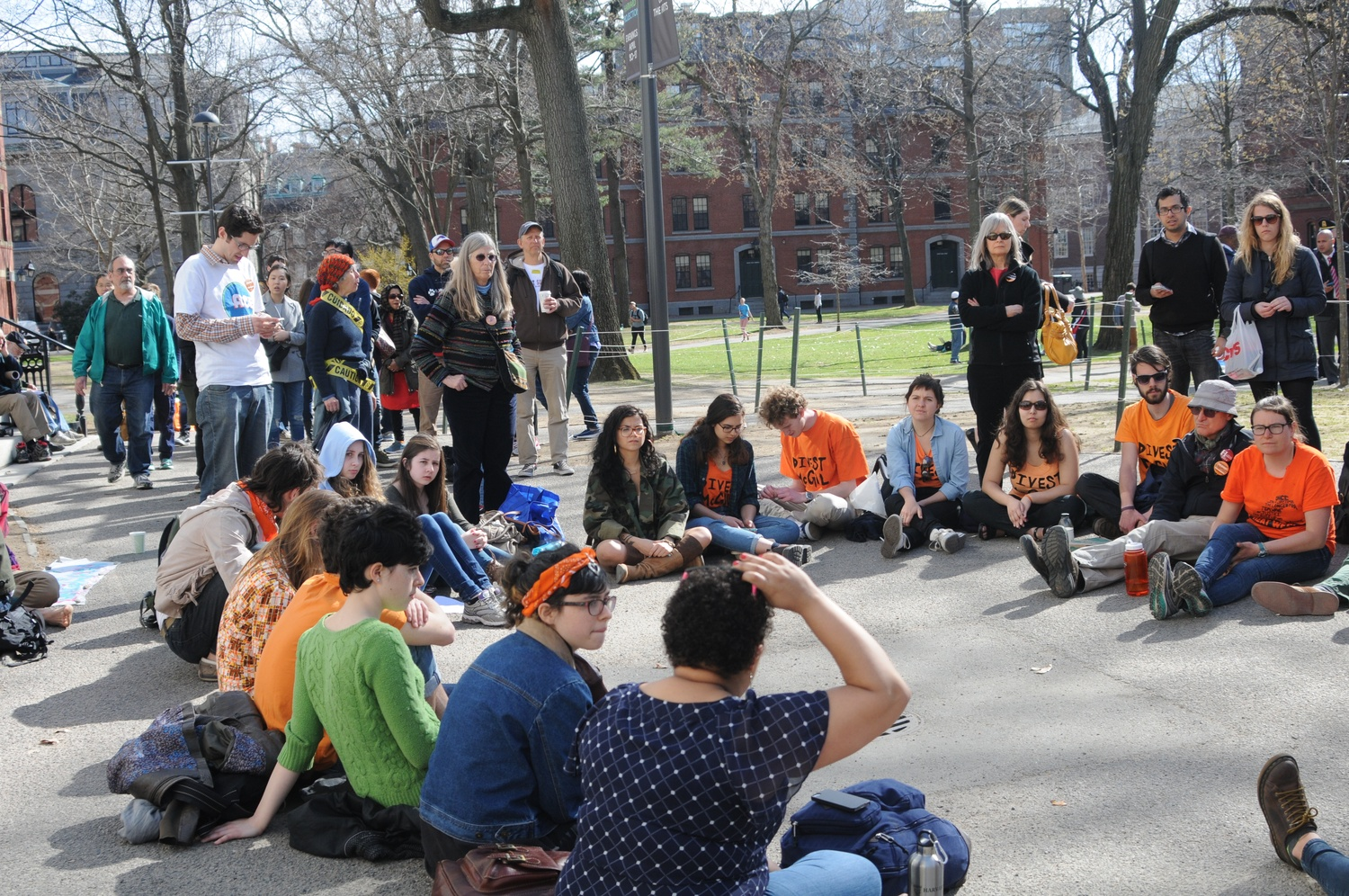"""Students activists from different schools gather near the John Harvard statue during an open forum. The event took place Wednesday afternoon as part of Divest Harvard's """"Harvard Heat Week."""""""