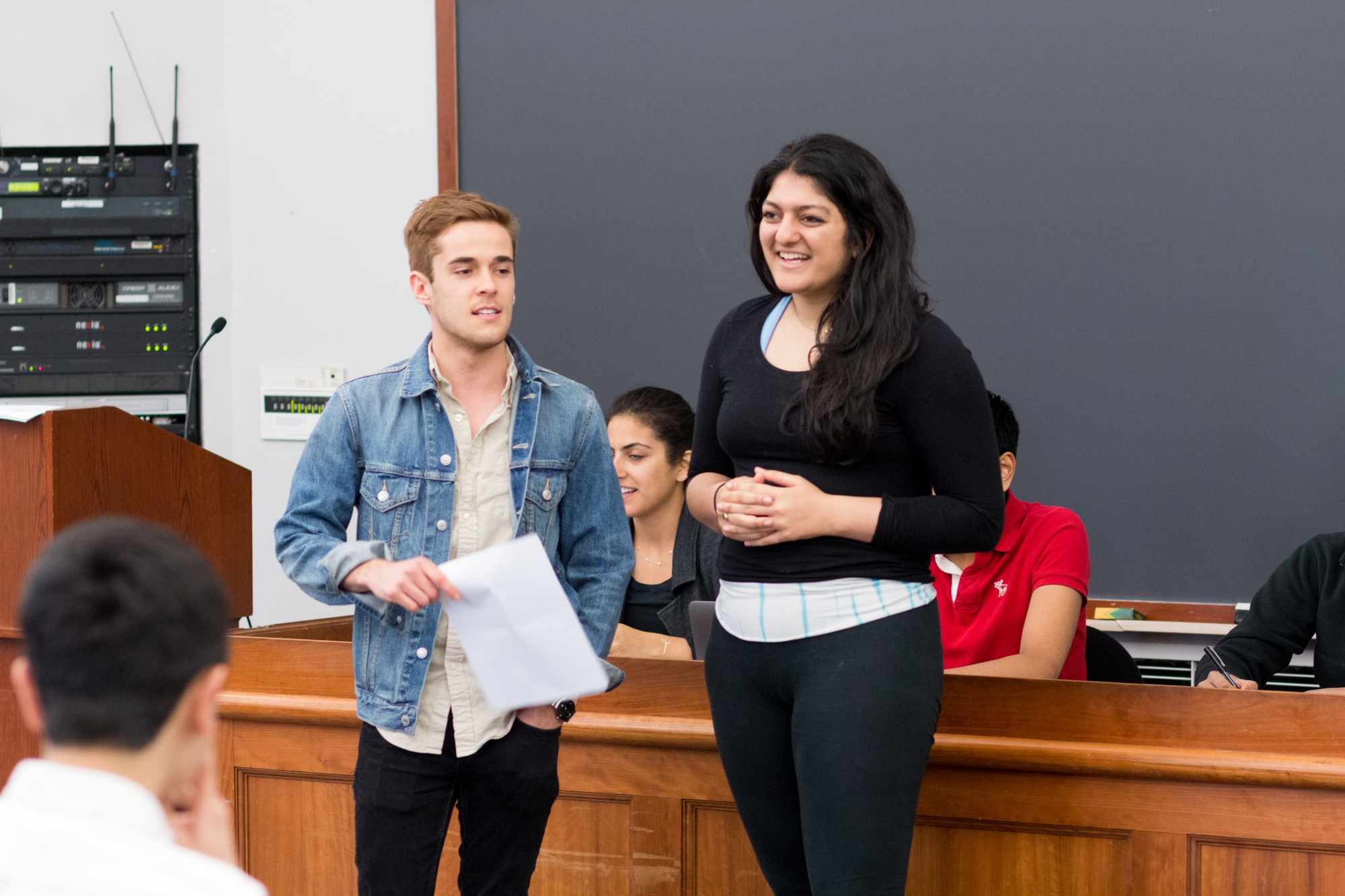 """Daniel V. Banks '17 and Shaiba Rather '17, co-chairs of the UC's Student Initiatives Committee, invite """"Harvard Project"""" winner Savannah M. Fritz '17 to speak in front of the Council."""