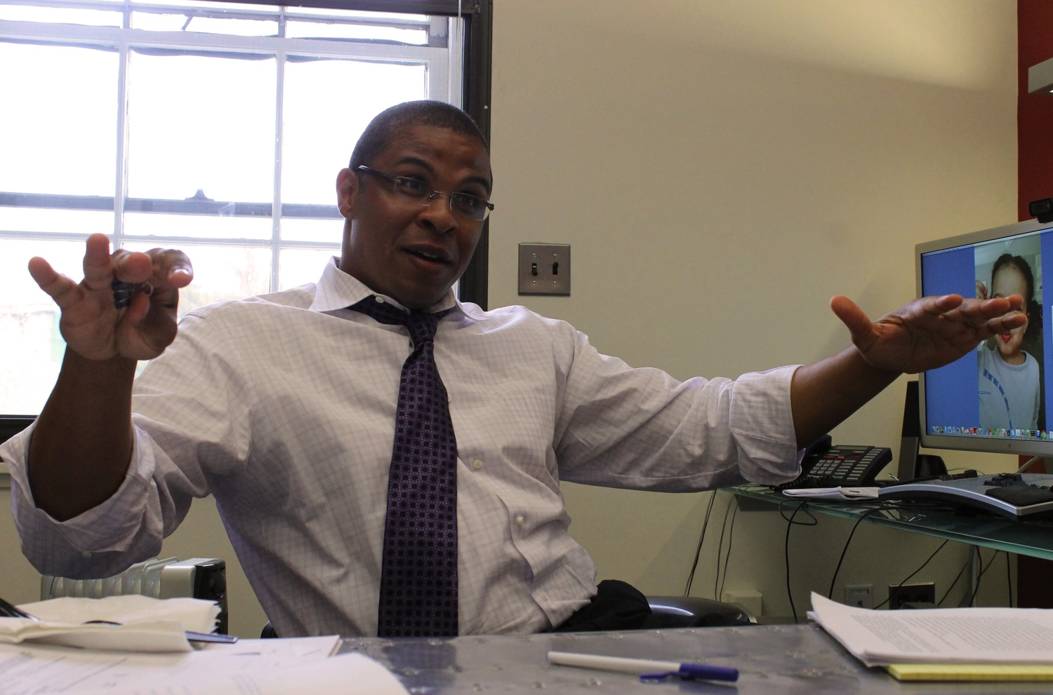 Roland G. Fryer, this year's John Bates Clark Medal recipient, speaks about his research on education for disadvantaged youths, influential mentors, and his two-year-old daughter on Monday afternoon in his office at Littauer Center.