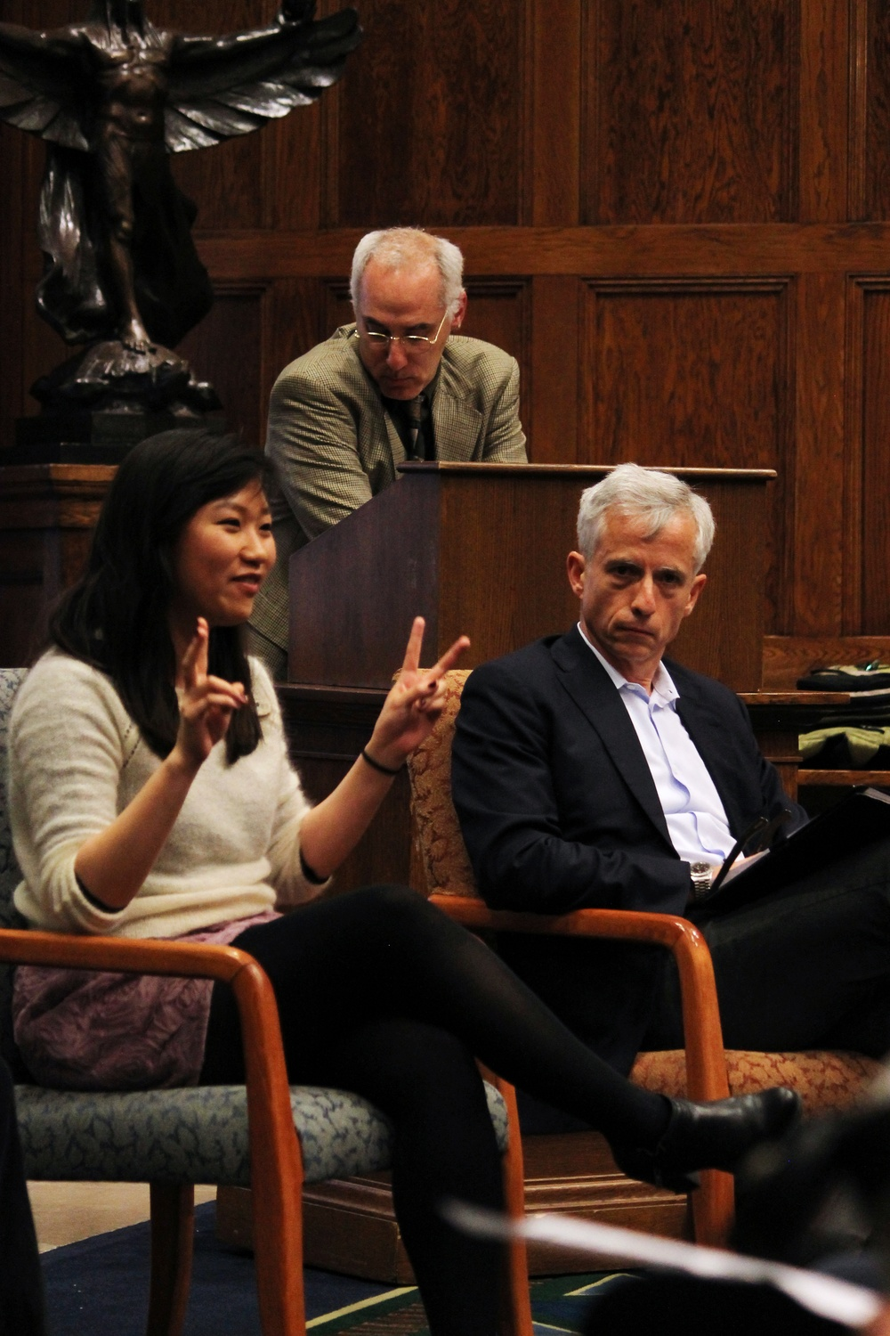 Olivia Z. Zhu '15, who has served on the Academic Integrity Committee for 3 years, speaks about honor codes at Harvard's graduate schools and Radcliffe College, and the student voice in creating the College's honor code at the Barker Center on Monday evening.