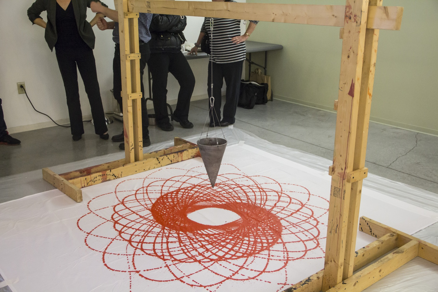 An interactive kinetic sculpture by Kim Bernard, a visiting Artist-in-Residence in the Physics department, shows how the laws of physics can be applied to create beautiful art forms Thursday evening at 29 Garden Street.