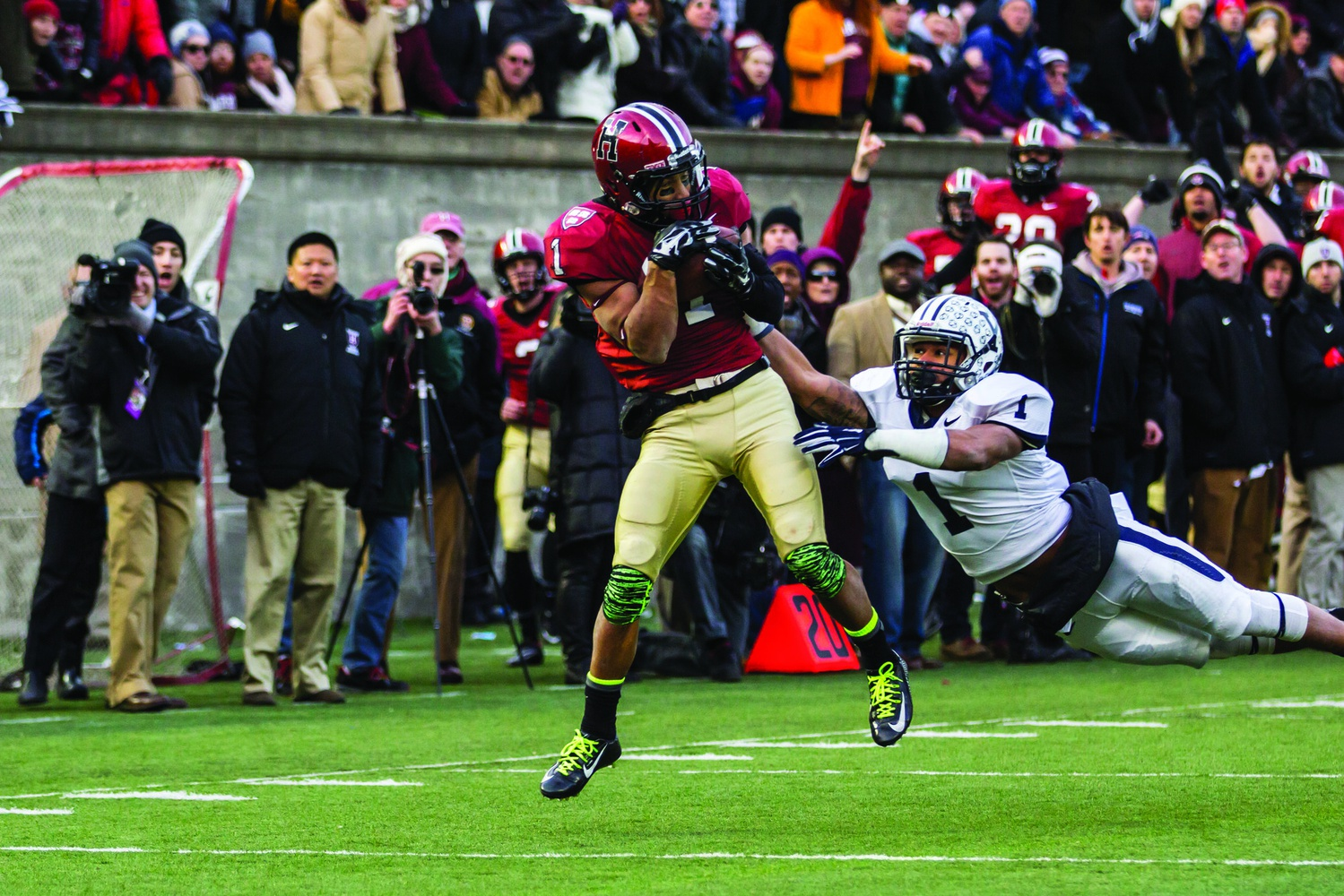A last-minute touchdown catch for senior wide receiver Andrew Fischer propelled the Harvard football team to an Ancient Eight title over archrival Yale.