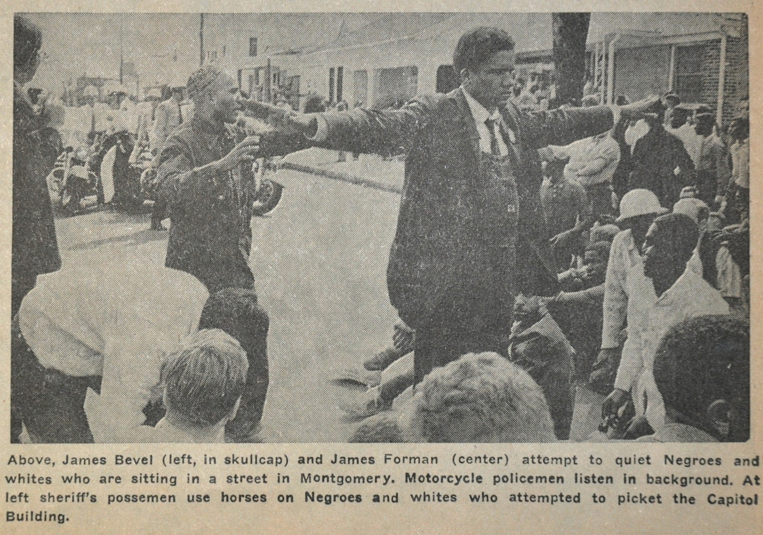 Above, James Bevel (left, in skullcap) and James Forman (center) attempted to calm people sitting in a street in Montgomery, AL. Motorcycle policemen listen in background. At left, sheriff's possemen use horses to interfere in a picket of the Capitol building.