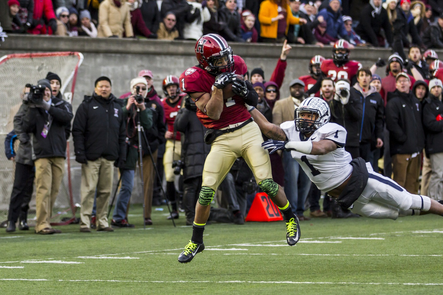 Andrew Fischer catches the game-winning score of the Harvard-Yale game on Nov. 22. The Crimson beat the Bulldogs, 31-24, in a thriller at Harvard Stadium that ensured sole possession of the Ivy title for Harvard.