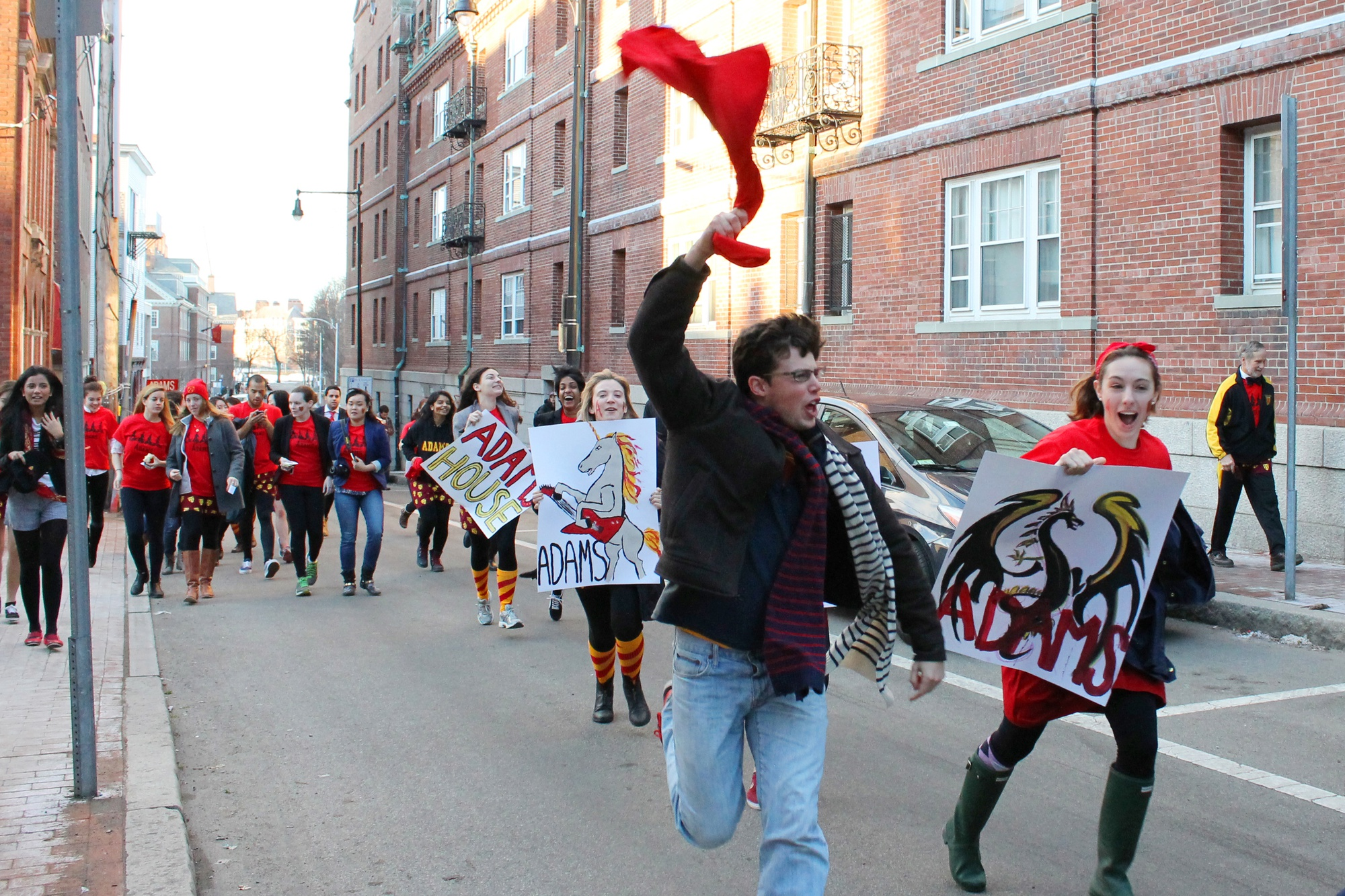 Students in Adams House sprint down Plympton Street to Harvard Yard to begin Housing Day festivities on March 12.