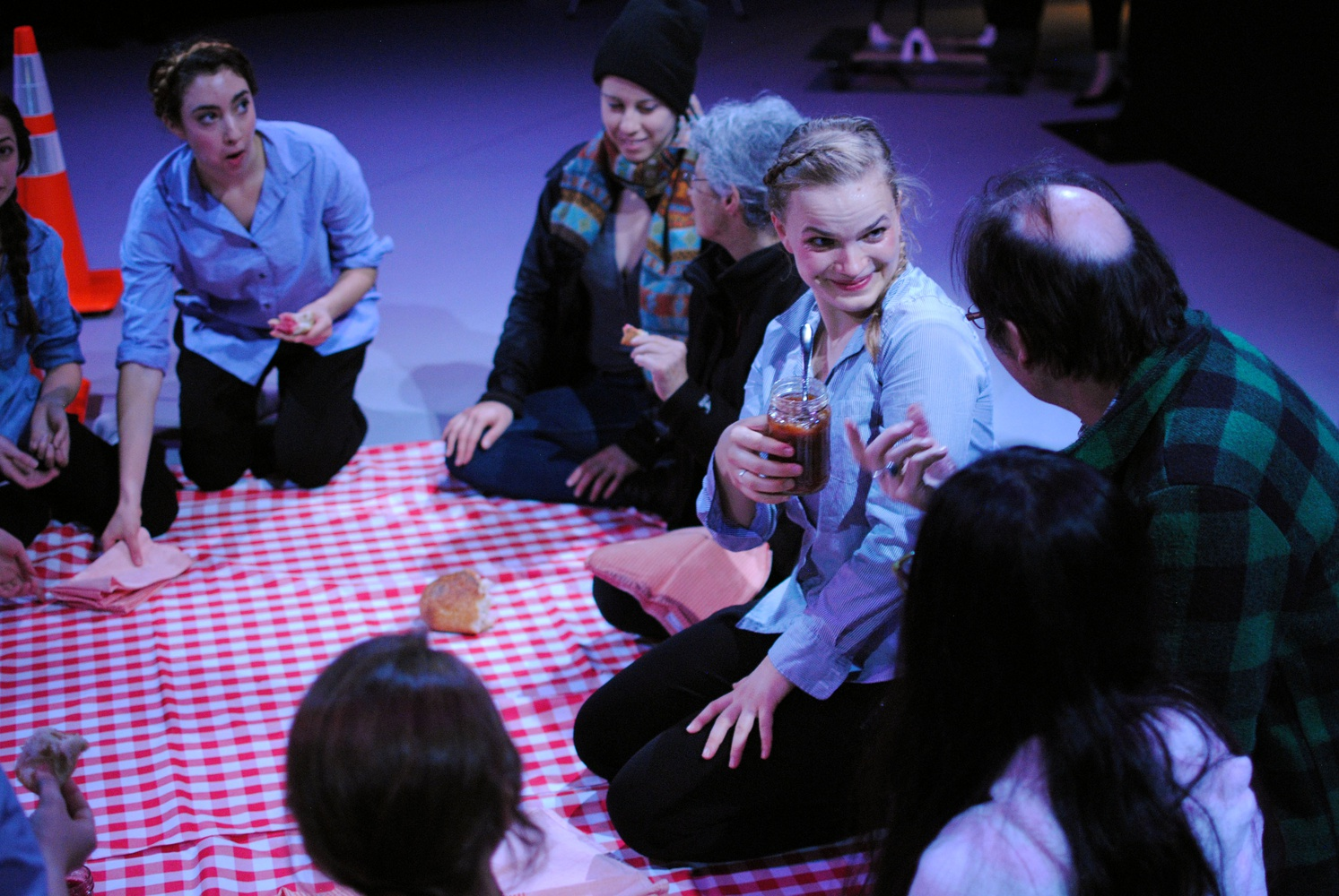 """Liza Batkin '15 offered jam to an attendee during the opening of the Harvard Dance Project's """"LOOK UP"""" in November. At one stage of the installation, dancers invited attendees to sit and eat bread."""