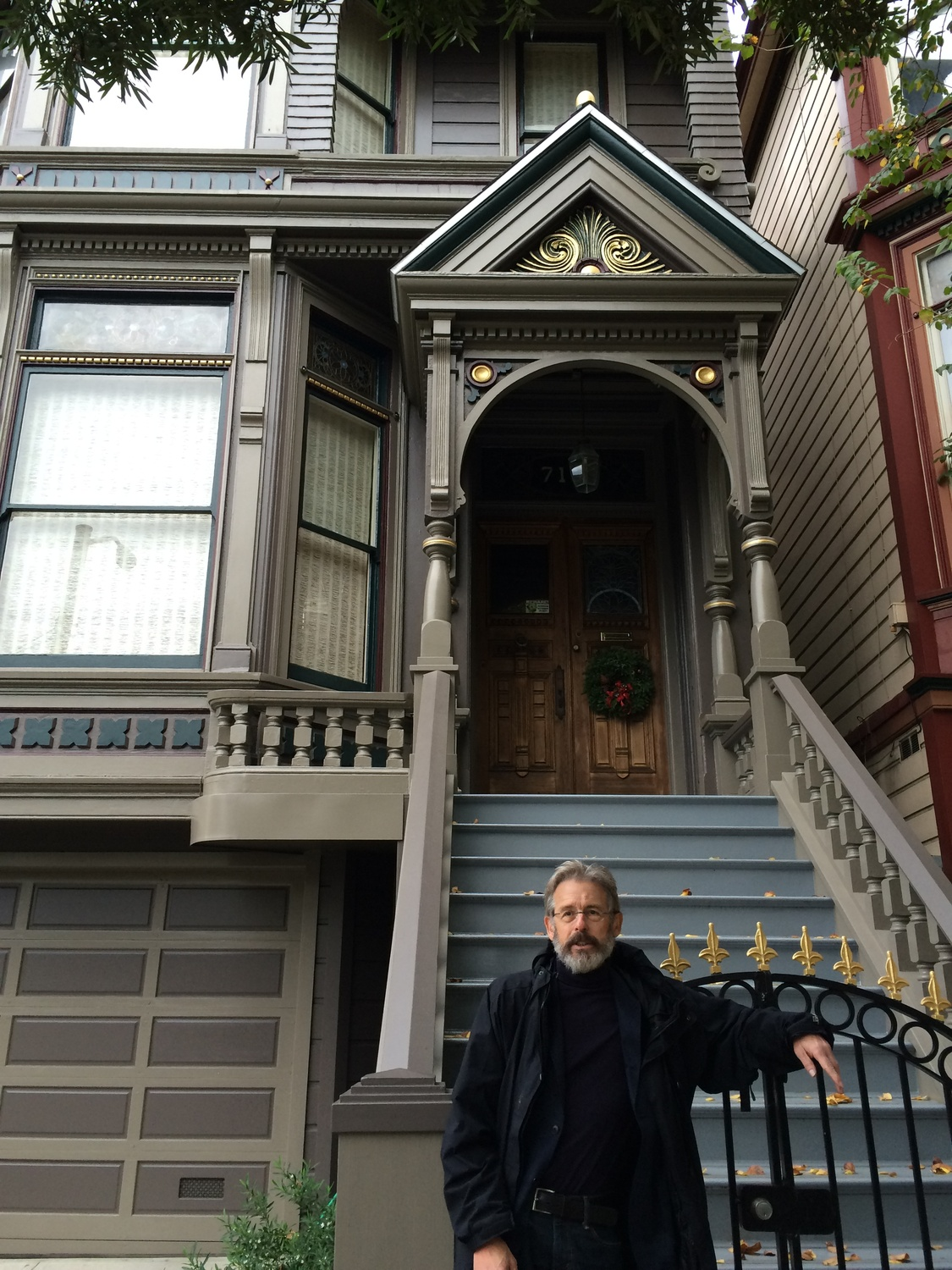 Former Crimson Managing Editor Hendrik Hertzberg '65 poses in front of the house of Jerry Garcia of the Grateful Dead in San Francisco.