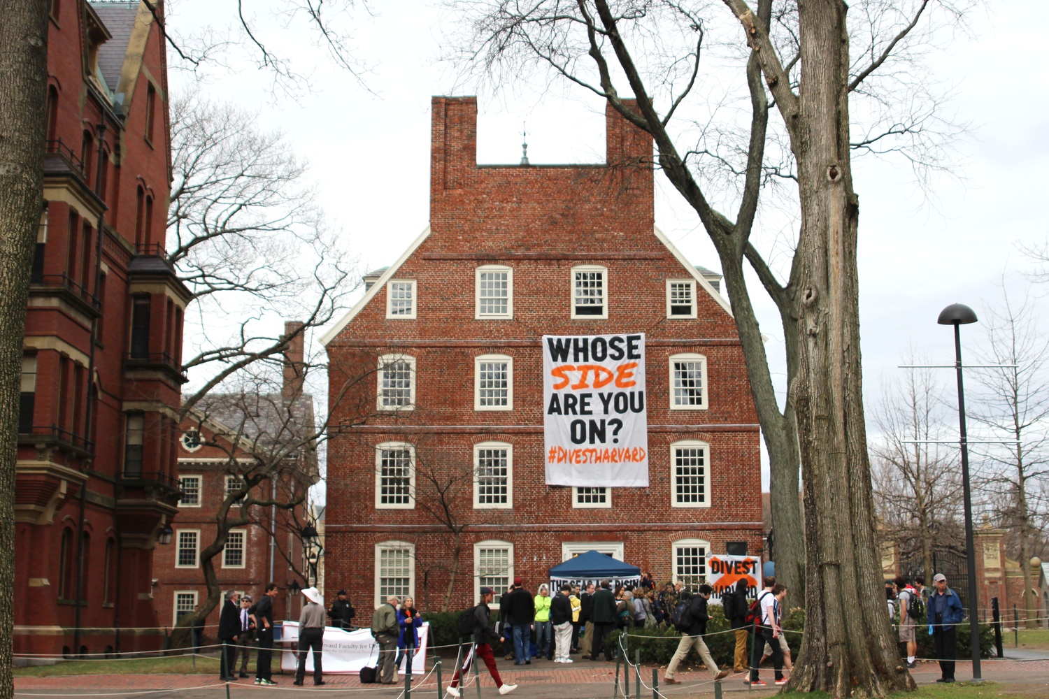 Protesters hang a banner from the upper floors of Massachusetts Hall on the second day of their weeklong April blockade of the administrative building, which houses University President Drew G. Faust's office.