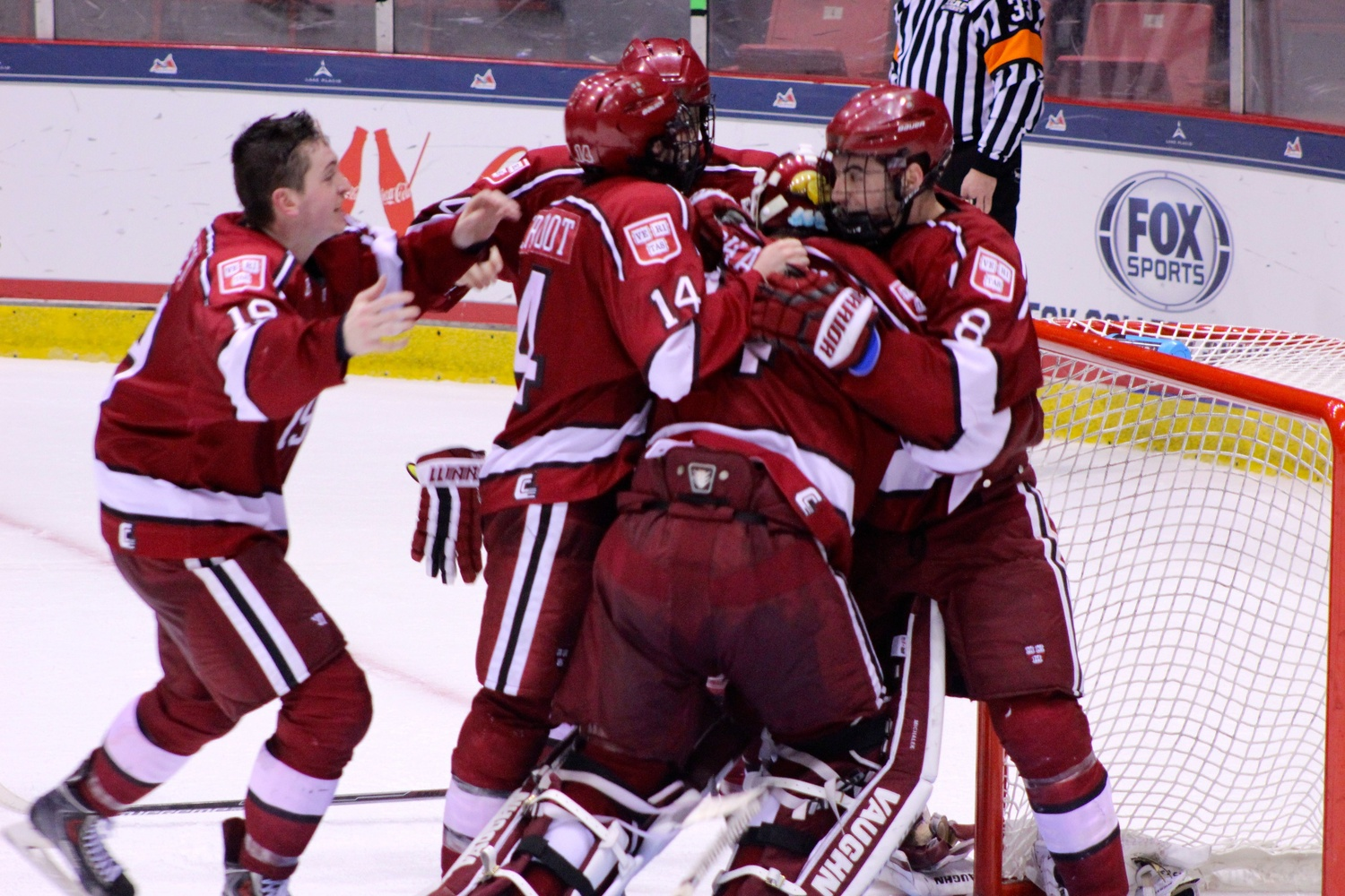 Fourth-year defenseman Patrick McNally (far right) celebrates with goaltender Steve Michalek and junior forward Jimmy Vesey (far left) after beating Colgate, 4-2, in the ECAC tournament final in Lake Placid, N.Y. on March 21.