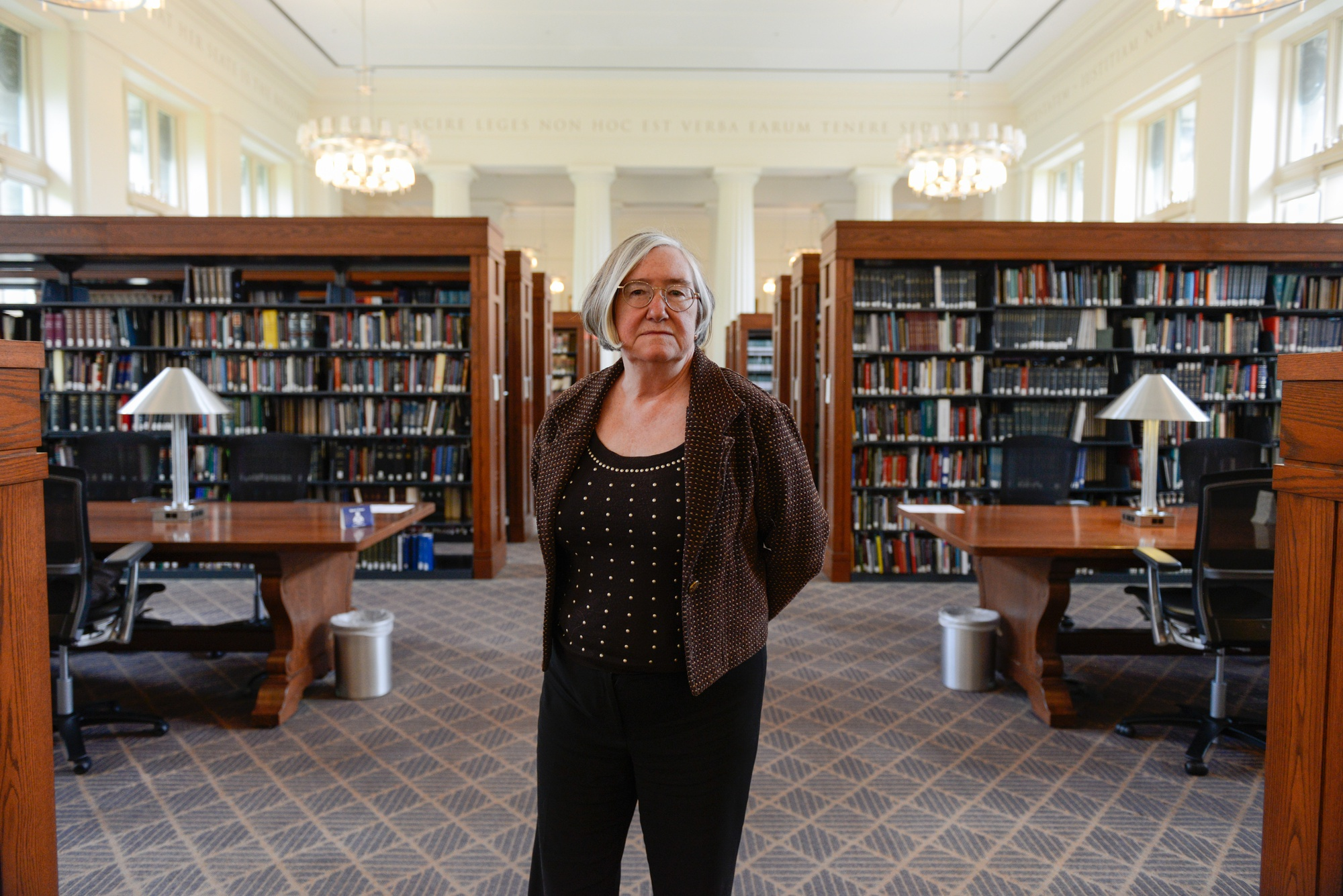 Janet E. Halley poses inside the Harvard Law School library, a place she defines as a quintessential location in the Law School experience.