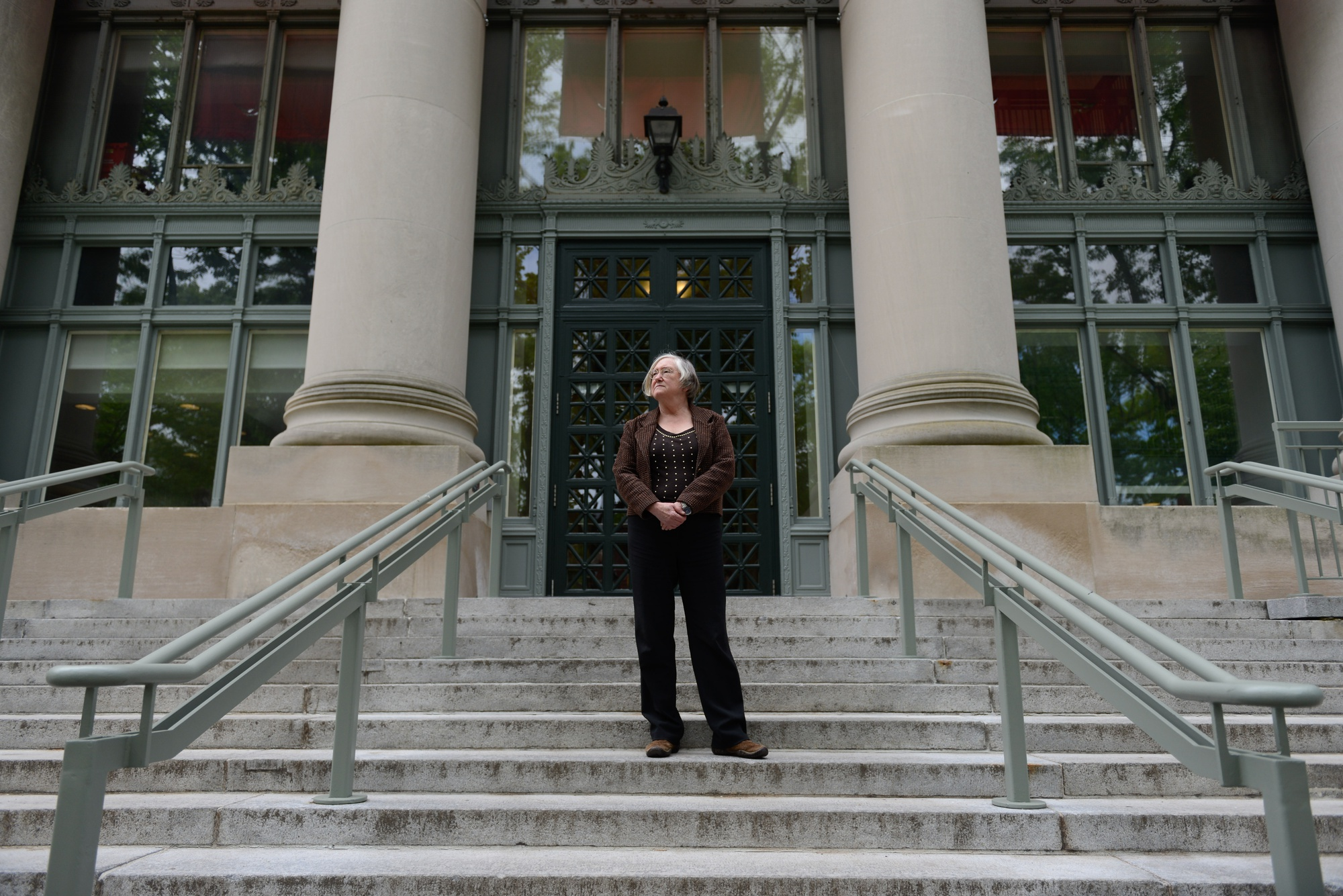 Janet E. Halley poses in front of the Harvard Law School library; Halley is a professor at the Law School who has pushed back against Harvard's central Title IX policy.