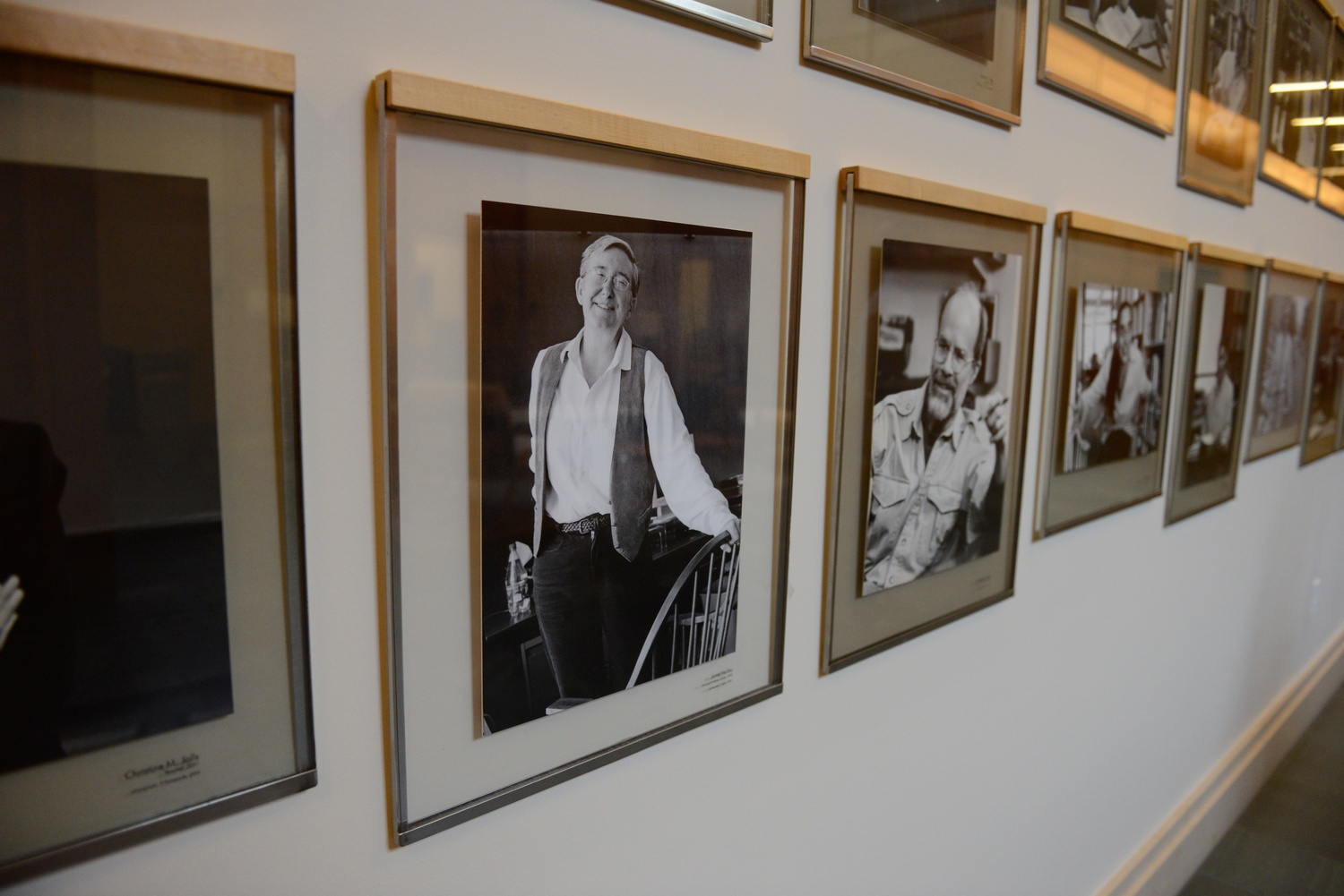 A portrait of Harvard Law School professor Janet E. Halley hangs in Wasserstein Hall next to images of other faculty members.
