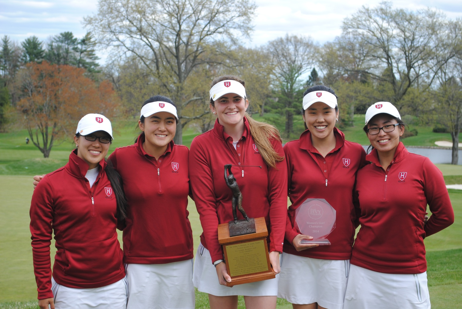 The Harvard women's golf team, pictured after its third-straight Ivy title win in 2014, became the first squad in Ancient Eight golf history to capture four-straight Ivy League titles this year under Crimson coach Kevin Rhoads.