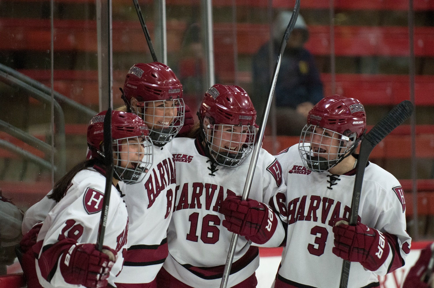 Junior forward Miye D'Oench (far left) celebrates during a 9-2 win over Boston University on Feb. 3 with three members of the Class of 2015—Hilary Crowe, Marissa Gedman, and Sarah Edney (from left to right).