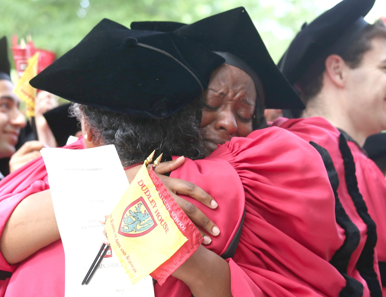 Jovonne J. Bickerstaff, who earned a PhD in Sociology, hugs Jacqueline C. Rivers, who earned a PhD in Sociology and African and African American Studies, as her degree is conferred during Commencement on May 28.