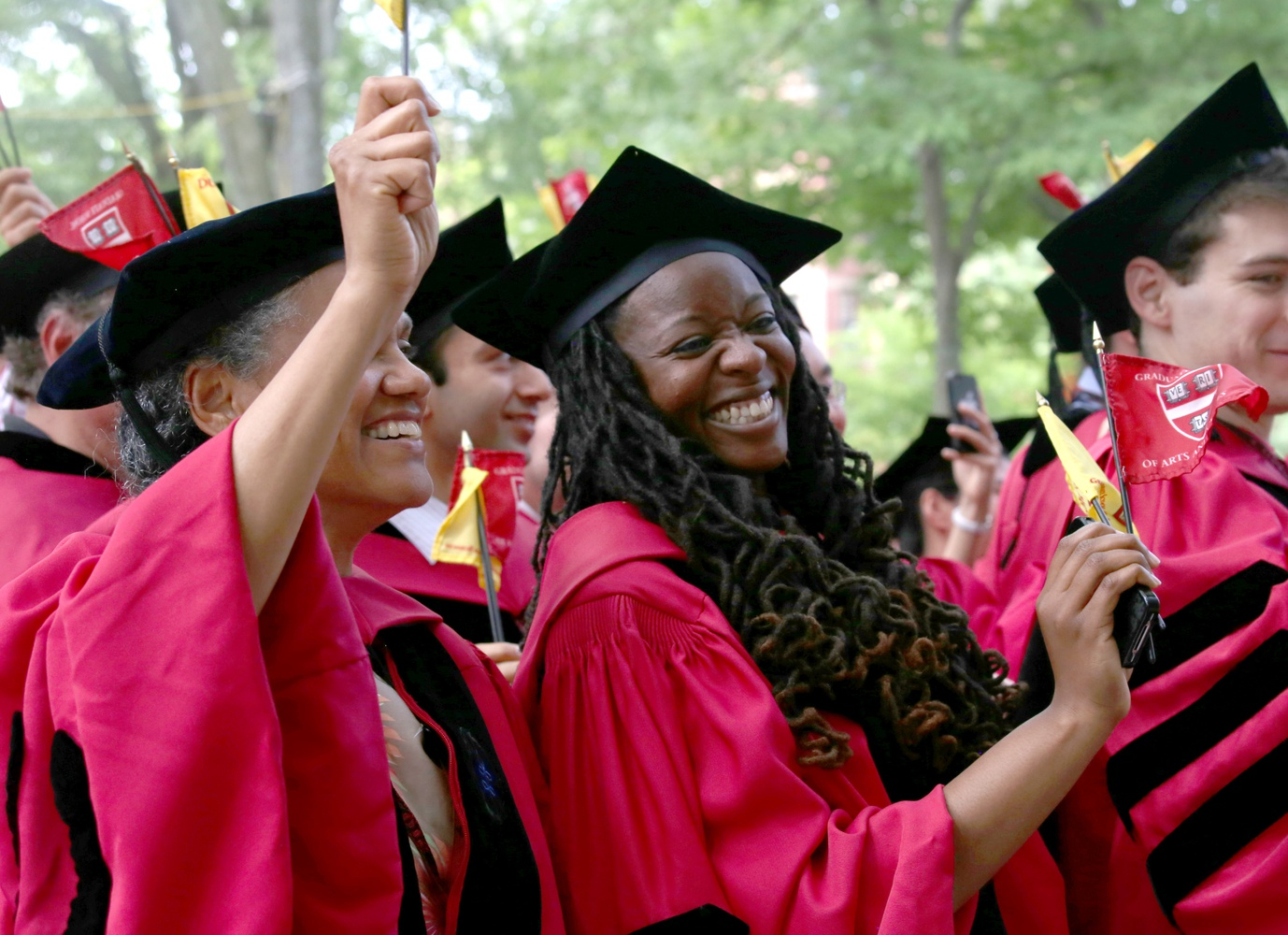 Jovonne J. Bickerstaff, who earned a PhD in Sociology, and Jacqueline C. Rivers, who earned a PhD in Sociology and African and African American Studies, celebrate during Commencement on May 28.