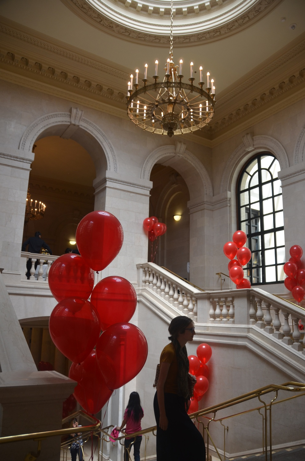 Visitors walk among red balloons at Widener Library last June. Administrators commemorated the 100th anniversary of the library's founding with a celebration.