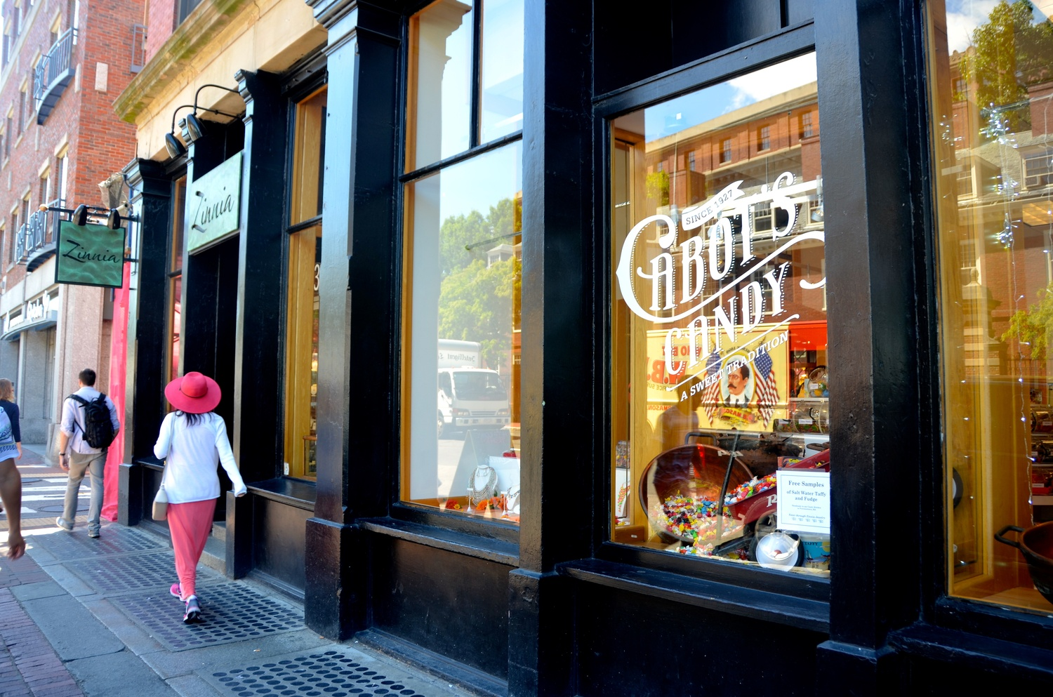 Passerby walk past Cabot's Candy in Harvard Square on Thursday afternoon. The store, which opened July 22, sells a variety of candy including salt water taffy and fudge.