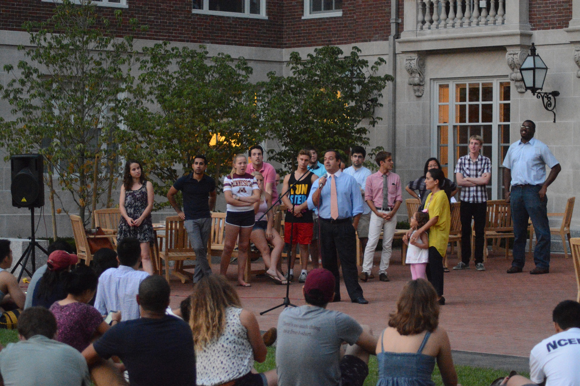 Carlos E. Díaz Rosillo, the Dunster House dean, addresses House residents at the House's tower relighting event on Tuesday.