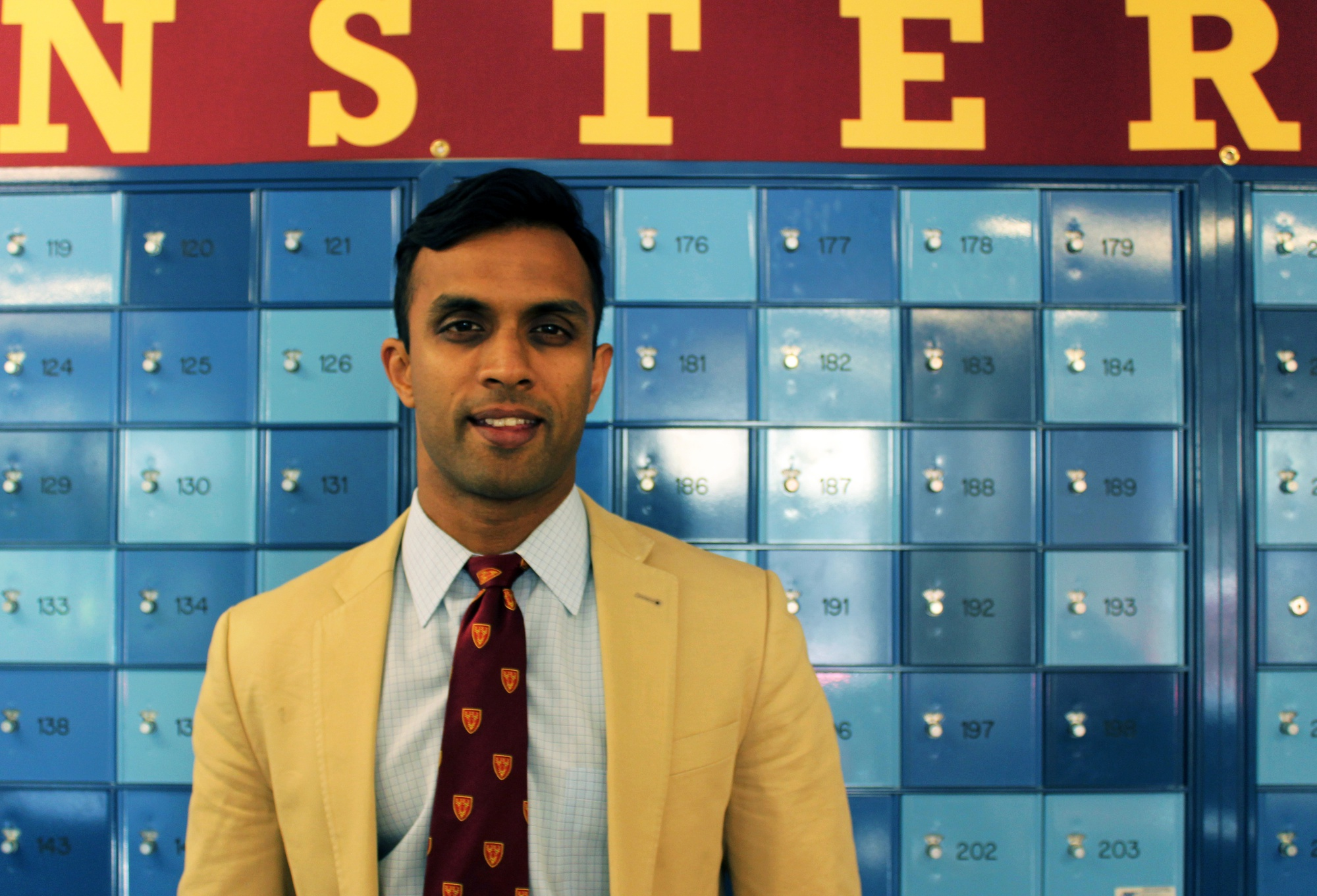 Avik Chatterjee '02, a former BGLTS, race relations, and pre-med tutor in Dunster House and now a tutor in Currier, poses before attending the Dunster Senior Dinner in May 2015.