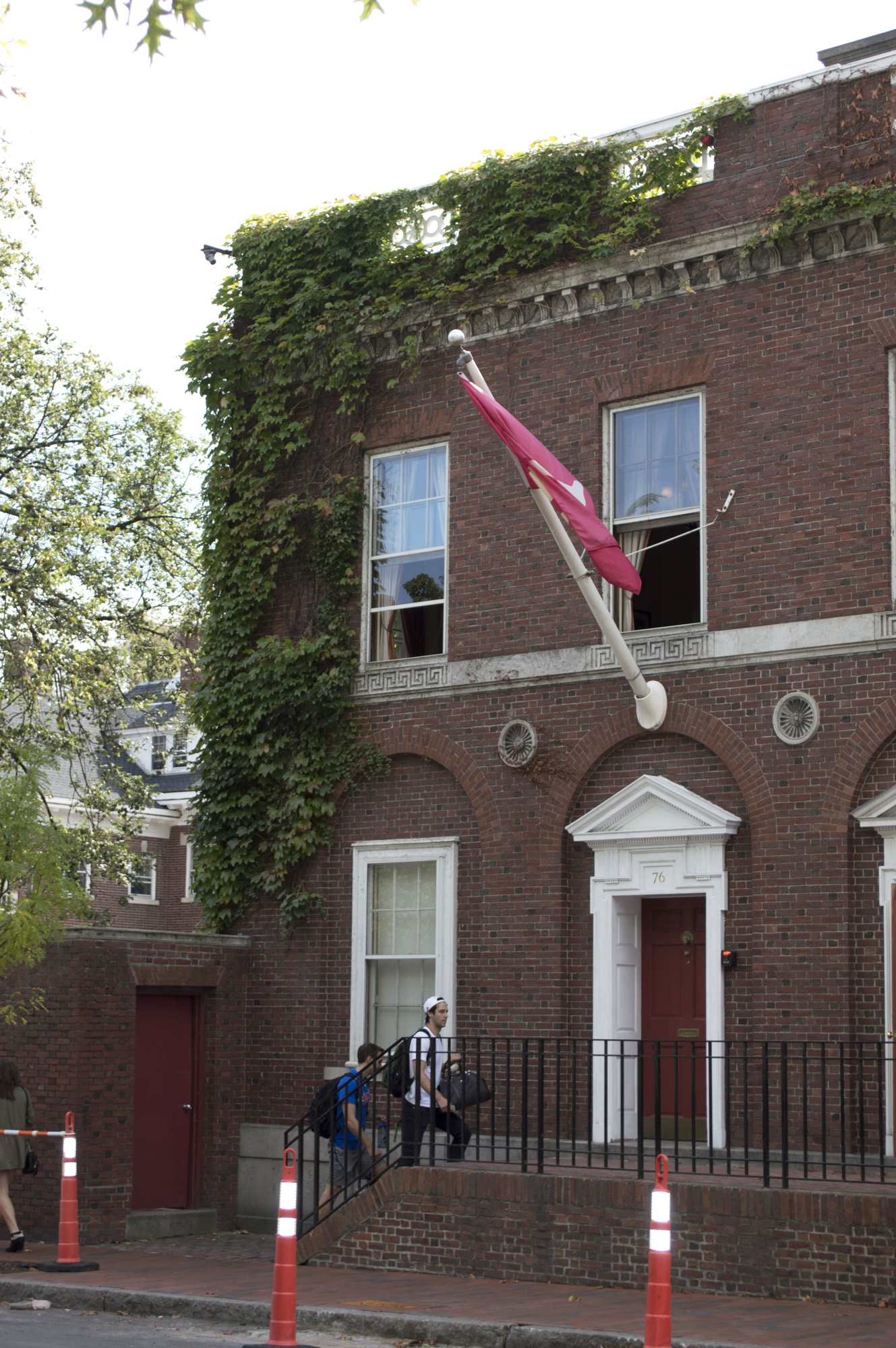 Two men enter the Spee Club on Saturday afternoon. The club became the first all-male final club to invite women to participate in its punch process this week.