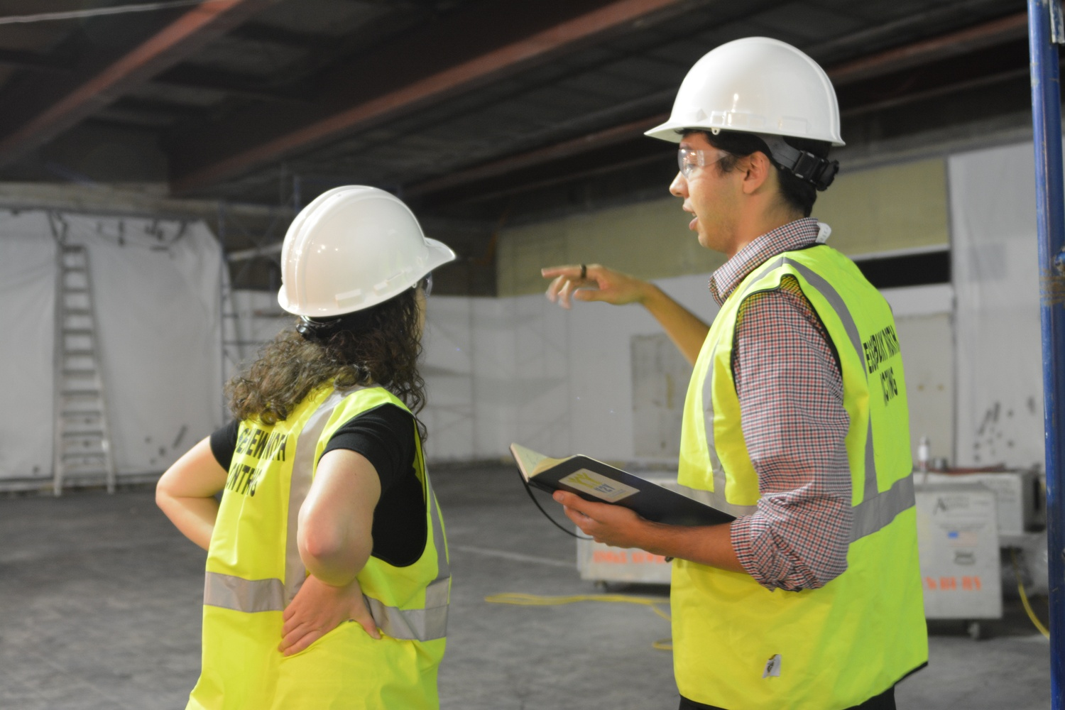 Y2Y Harvard Square co-directors Samuel G. Greenberg '14 and Sarah A. Rosenkrantz '14 discuss construction plans in the heart of the soon-to-be shelter in September.