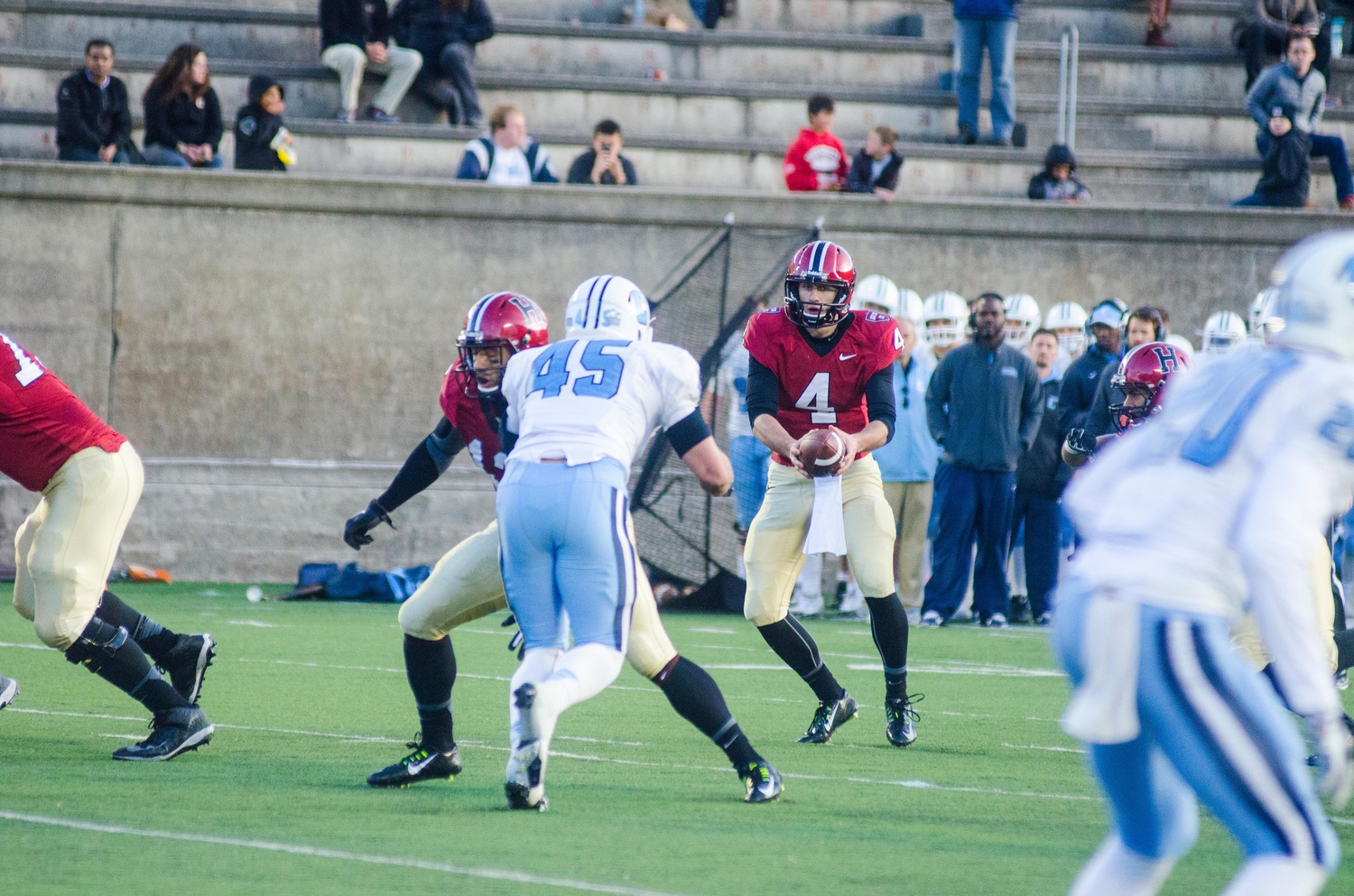 Harvard junior quarterback Joe Viviano, pictured above in Nov. 14, 2014 action against Columbia, will not play the rest of the season, according to Harvard coach Tim Murphy. Viviano played sparingly his first two years with the team but was locked in a battle for the starting job with senior Scott Hosch.