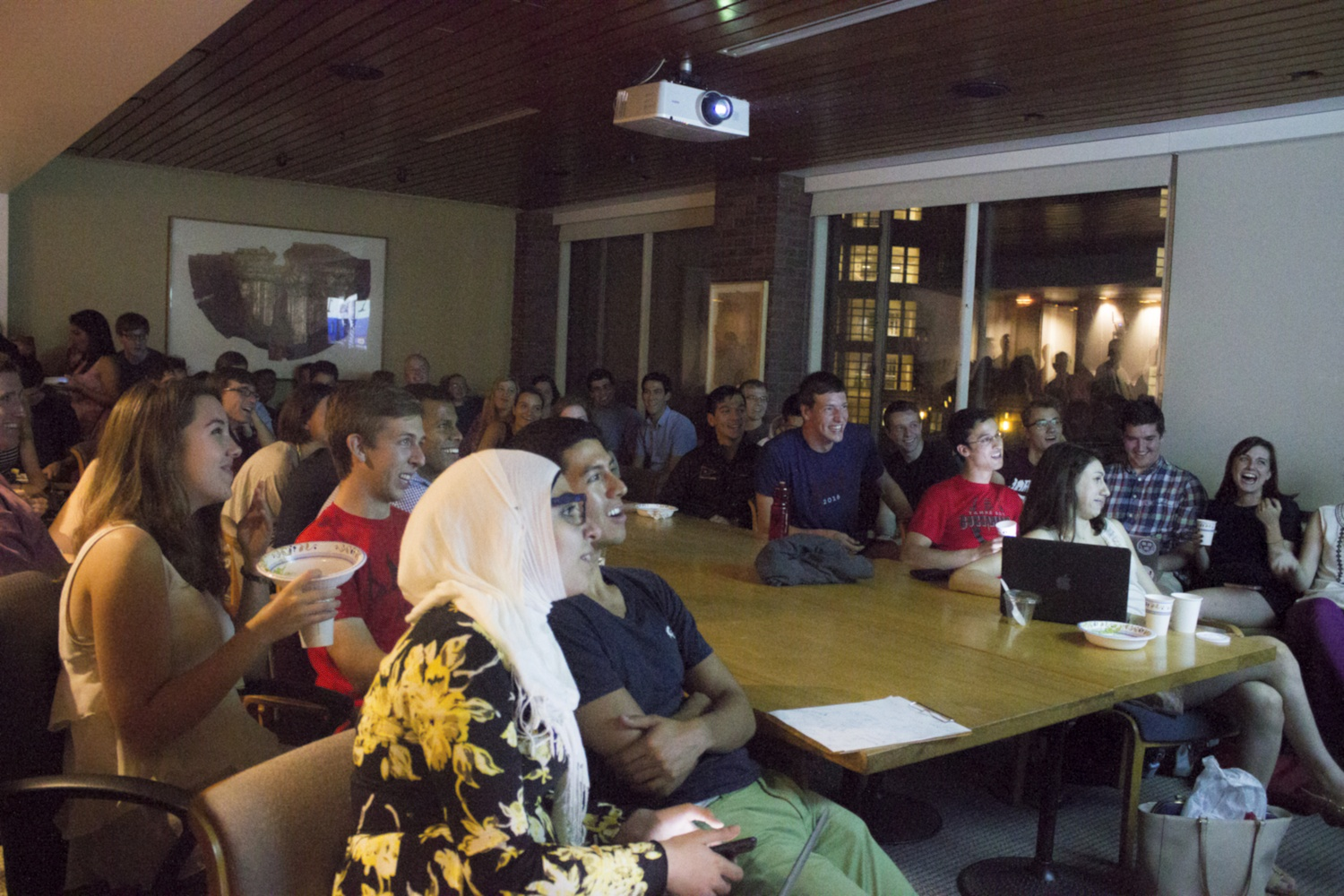 Members of the Harvard Republican Club and other students watch the Republican primary debate on CNN. The event filled three rooms at the IOP.
