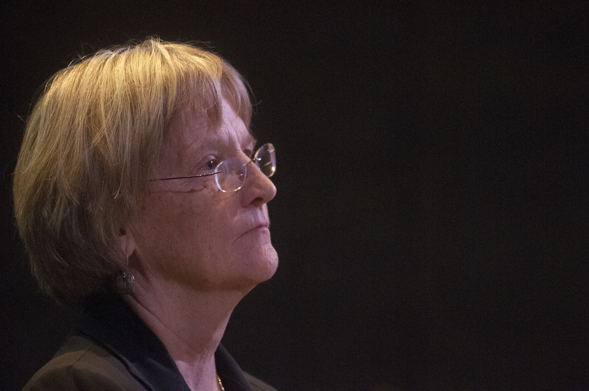 University President Drew G. Faust listens to comments during an open forum following the release of results of the sexual conduct climate survey on Monday.