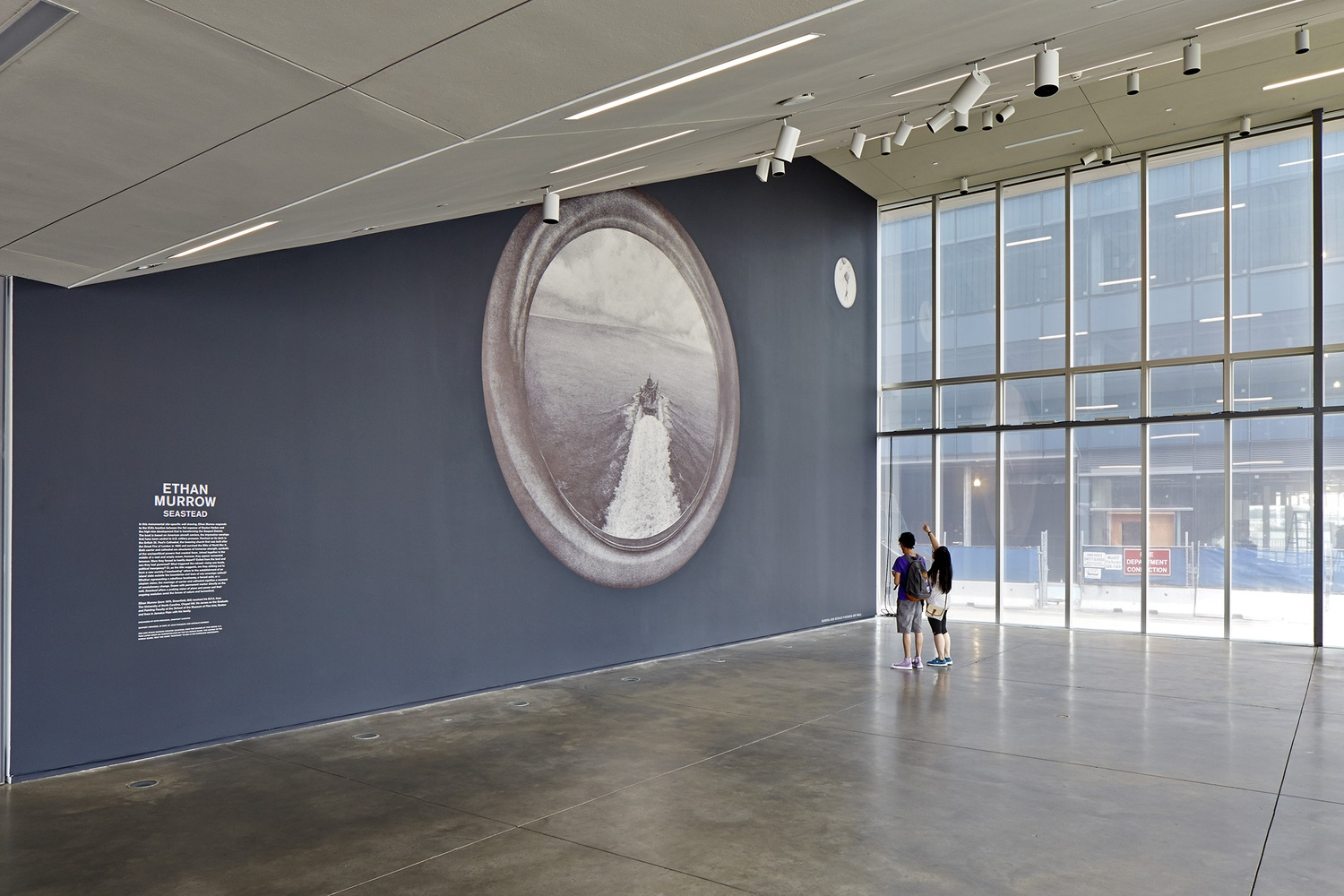 """Ethan Murrow's installation """"Seastead"""" rests in the Sandra and Gerald Fineberg Art Wall of the front lobby of the Institute of Contemporary Art."""