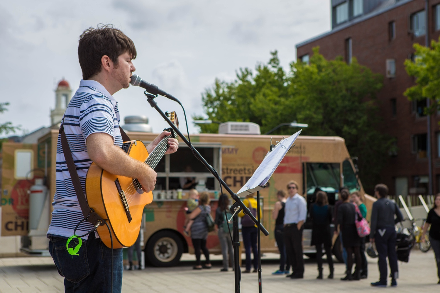 Patrick Yerby, a local musician, plays the guitar and sings at the most recent Pop Up Performance on Tuesday afternoon in the Science Center Plaza. Yerby plays a range of cover and original songs.