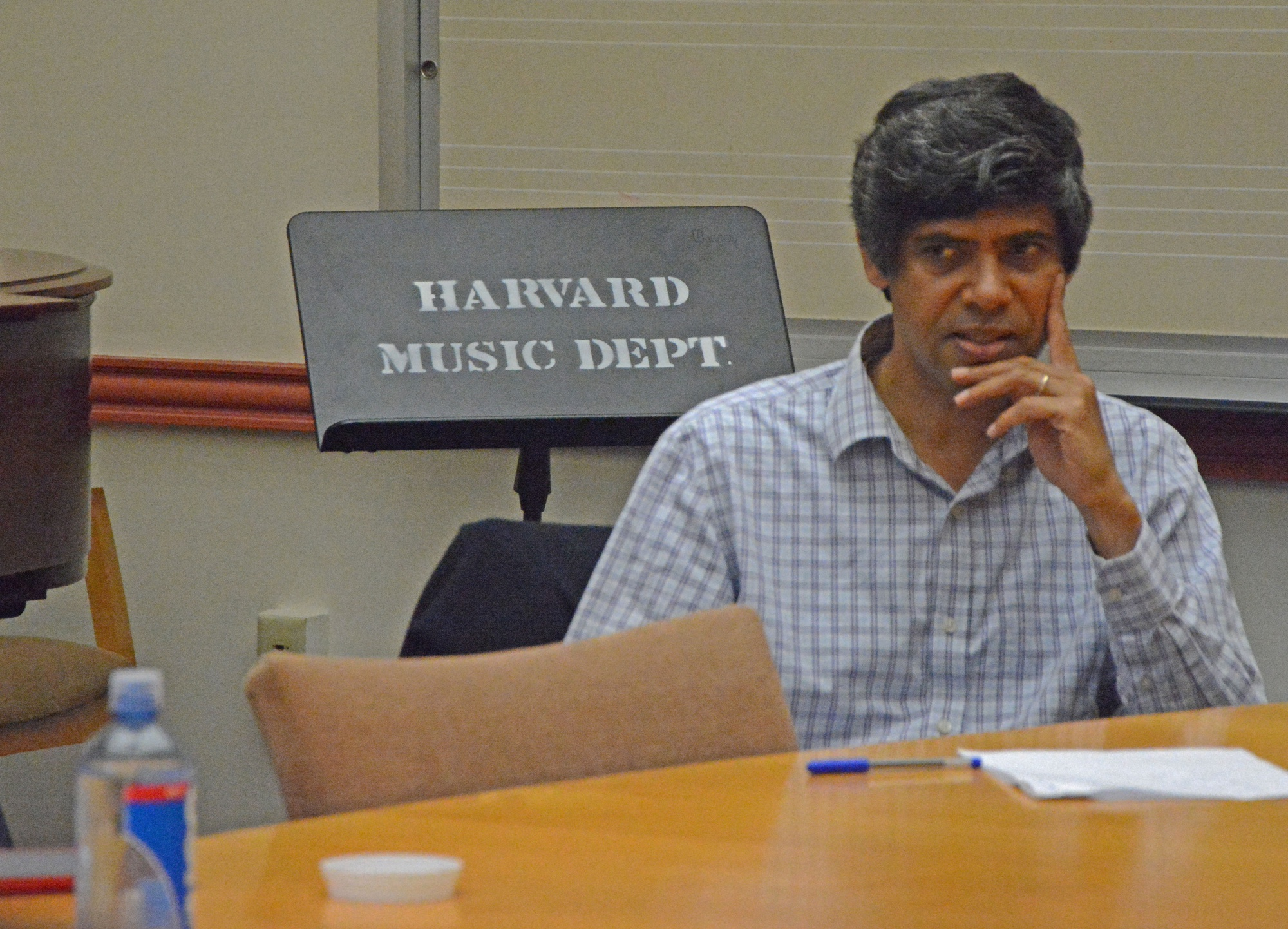Aniruddh D. Patel, a professor at Tufts University, talks about his course on cognitive science and music with Harvard students and faculty in the music department room on a Wednesday afternoon. They discussed different ways to redesign music concentration requirements.