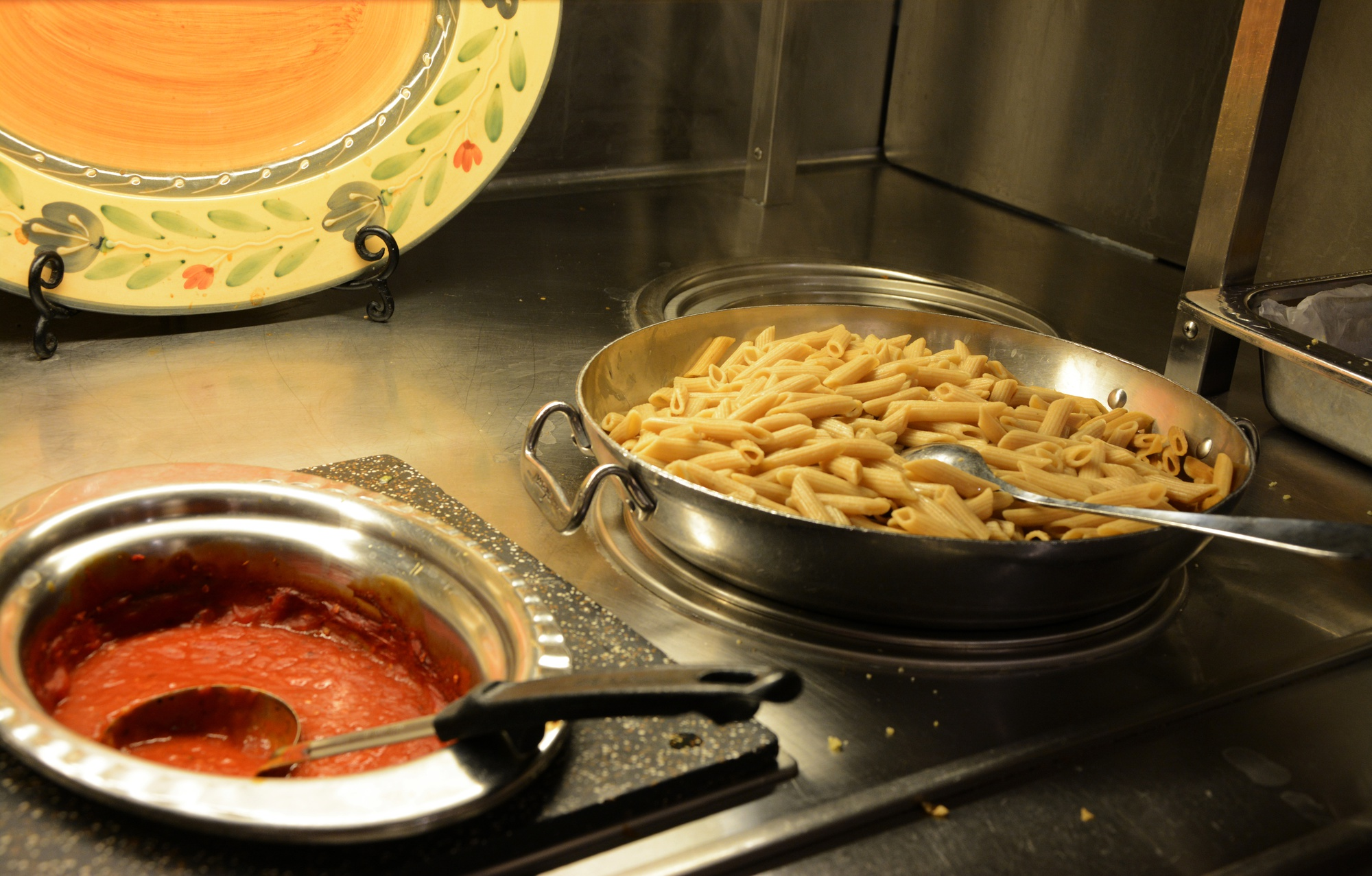 Pasta is served in Eliot House's dining hall on Wednesday evening. This semester, HUDS debuted a new pasta sauce made with locally-grown tomatoes.