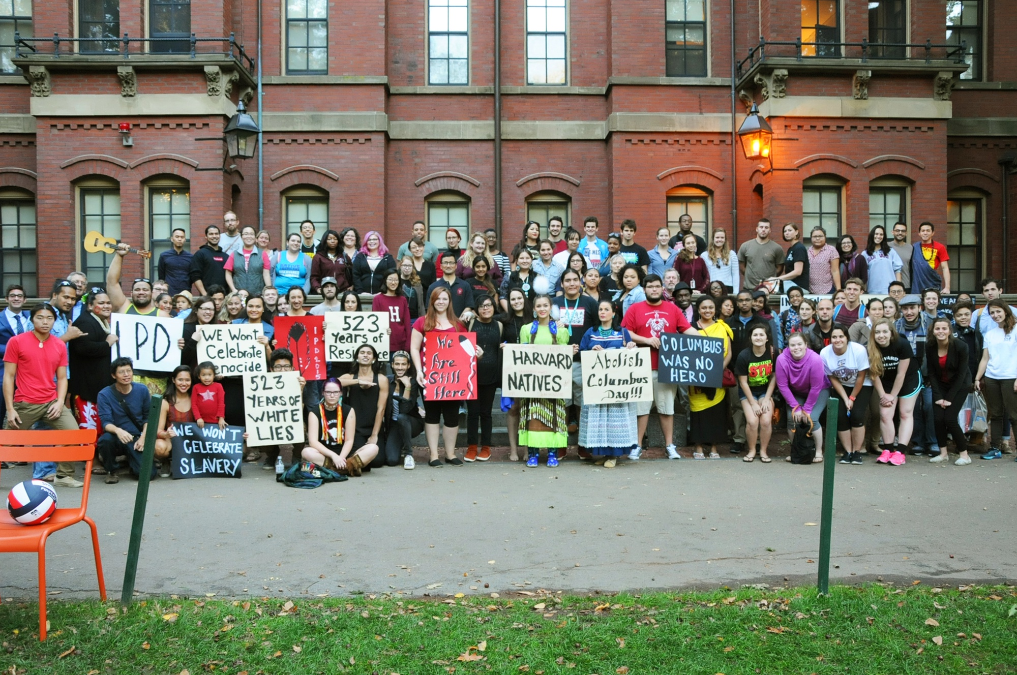 Performers and audience members at the Indigenous Peoples' Day celebration pose for a photo in Harvard Yard on Monday.
