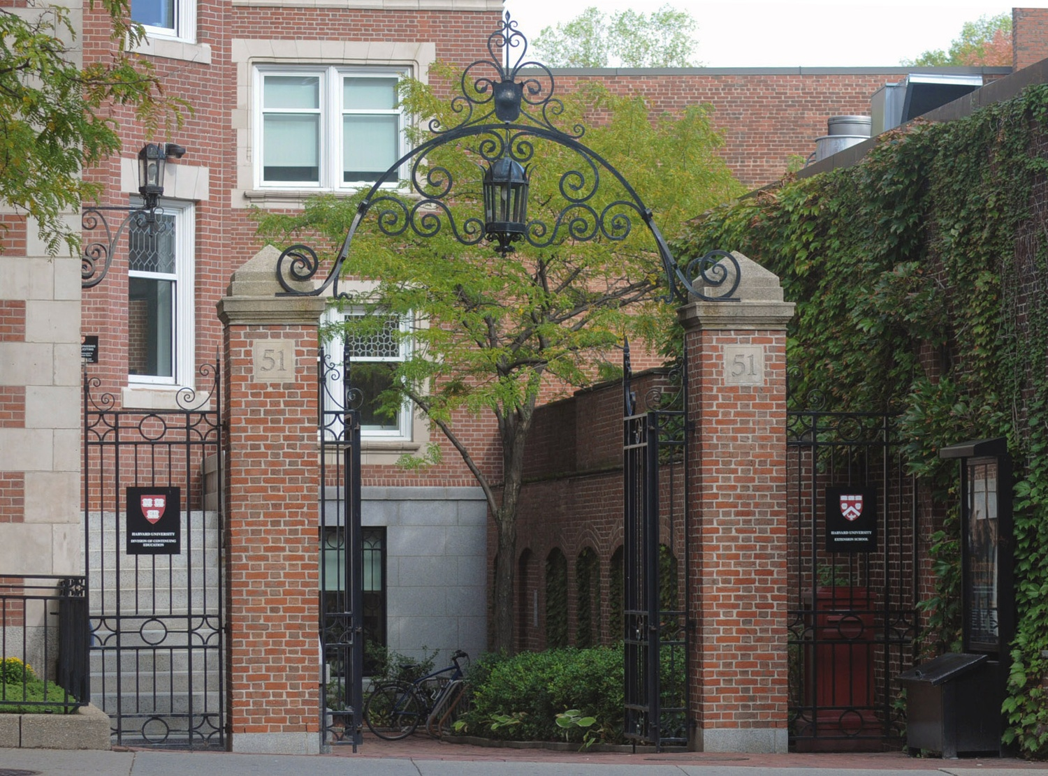 The gate entrance to the Harvard Extension School's administrative offices, pictured in 2015.