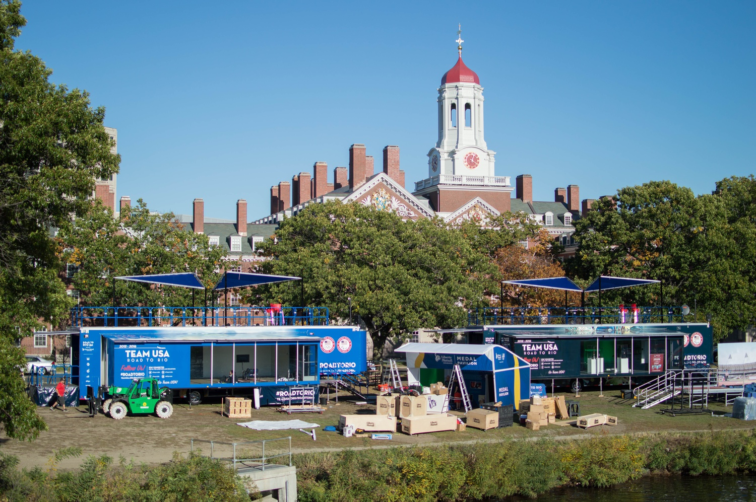 """Two large containers labeled """"TEAM USA"""" are sprawled out in front of Dunster House in preparation for this weekend's Head of the Charles regatta. The annual competition, held over the span of two days, is slated to begin this Saturday."""