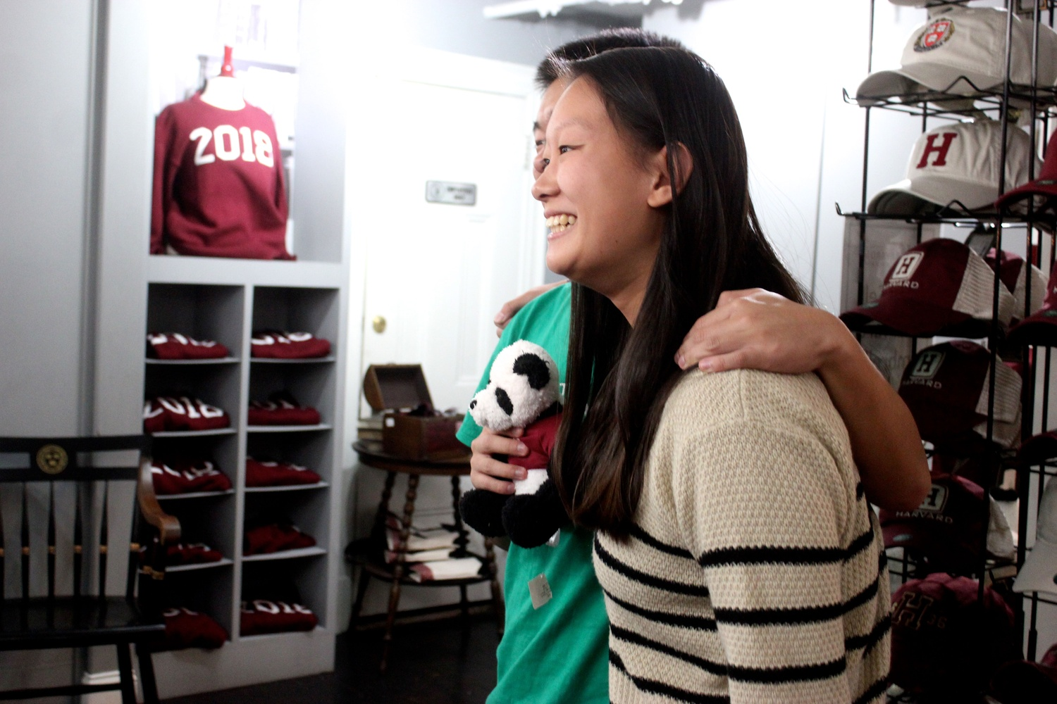 Jessica Li '17 poses for a picture at the H sweater release party in the Harvard Shop.