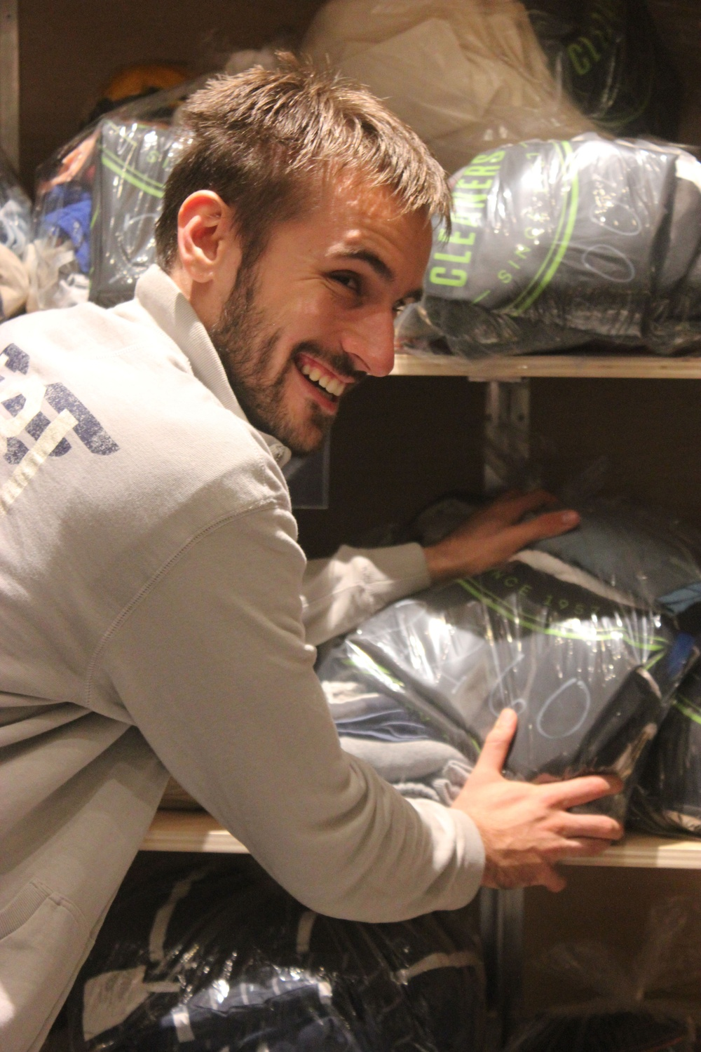 Luka Kordic loads bags of laundry off the shelf in preparation for a delivery run to the Yard dorms.