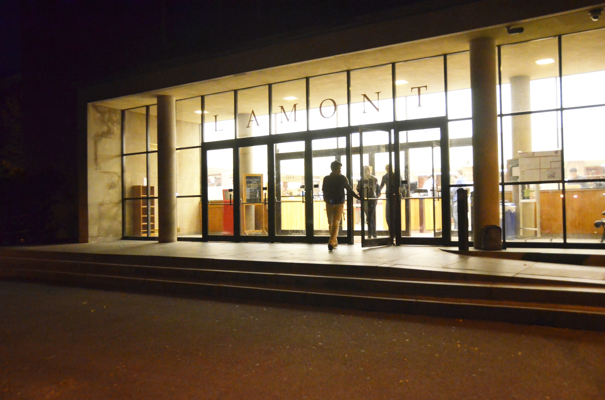 Students exit Lamont Library on Monday evening.