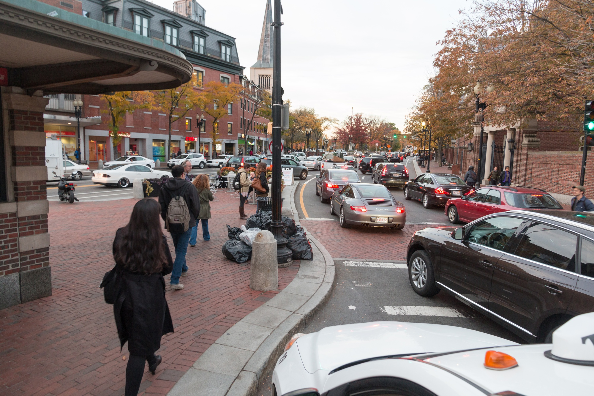 Traffic moves in Harvard Square.