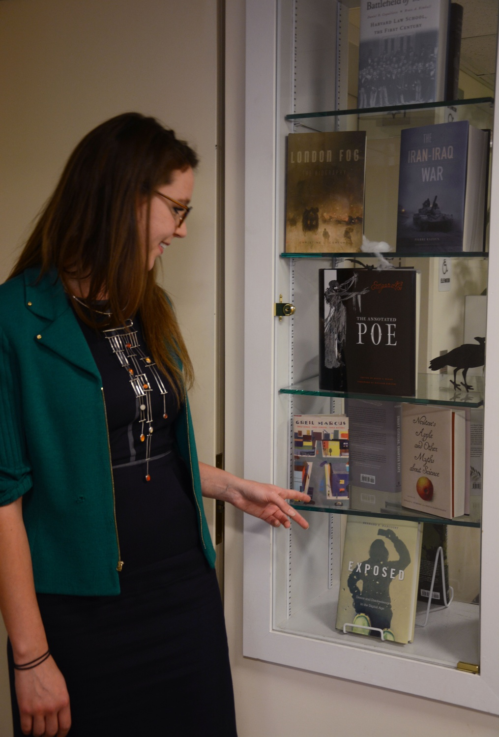 Amanda Peery '14 showcases a few of the books she has work on during her time at Harvard University Press. Peery concentrated in English during her time at Harvard.