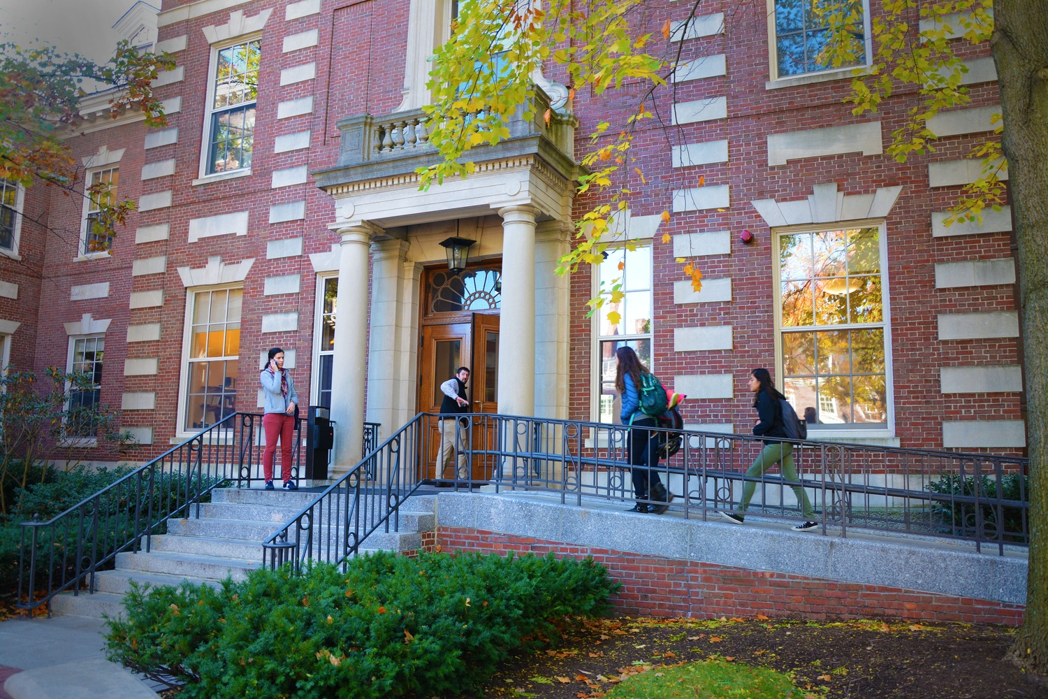 Students and faculty flow in and out of the Barker Center, home to the Humanities Center at Harvard, on a Monday morning.