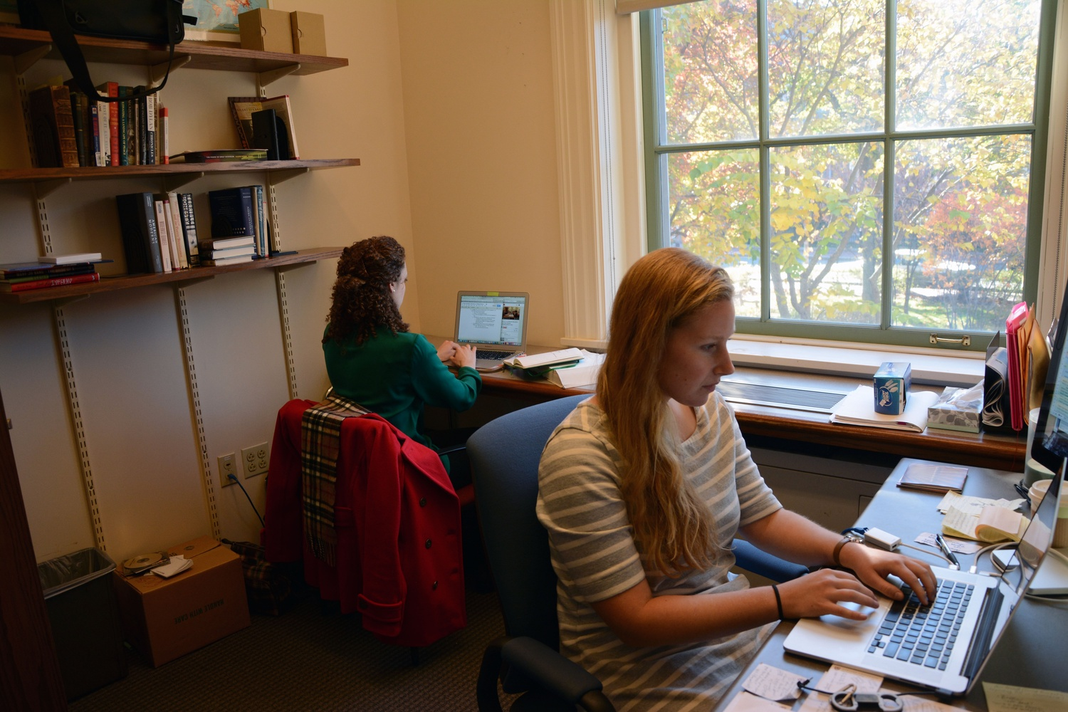 """Leah Reis-Dennis '13 and Caitlin M. Ballotta '14 work in the """"Poetry in America"""" office at the Barker Center. Their day-to-day work ranges from close reading poems to coordinating legal agreements with artists' estates."""