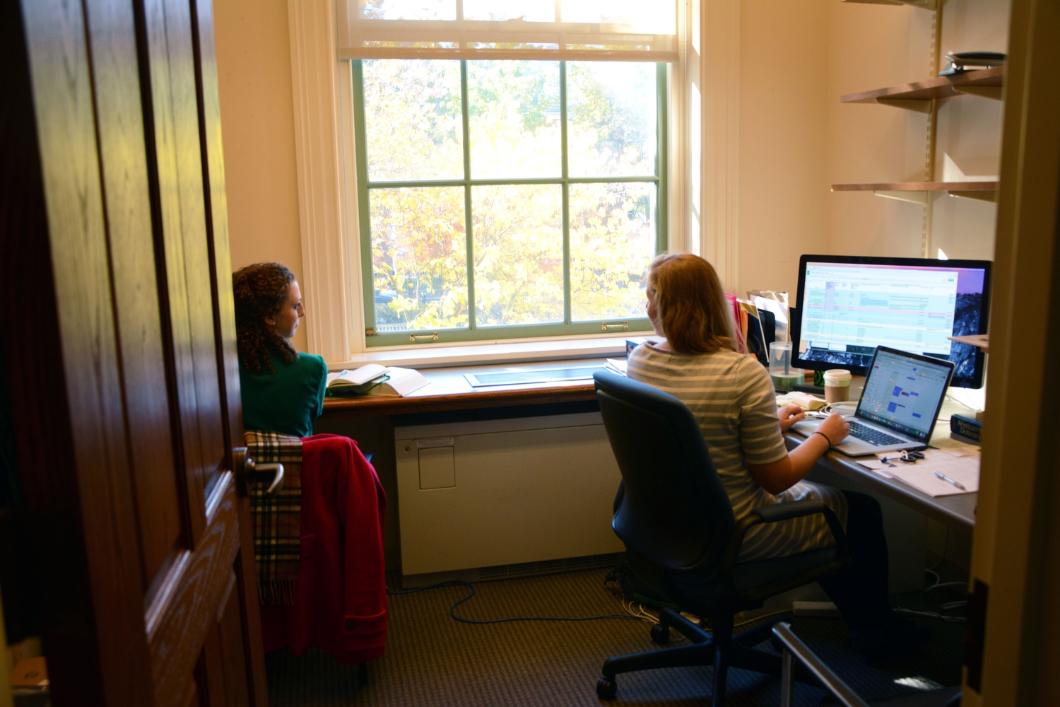 "Leah Reis-Dennis '13 and Caitlin M. Ballotta '14 work in the ""Poetry in America"" course offices. ""It'd be a little idealistic for me to say that you can find your dream job right off the bat,"" Reis-Dennis acknowledges. ""I like to joke I'm the only person who studied poetry in college who's now making a living working in poetry."""