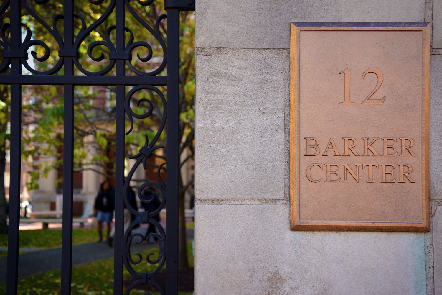 The gate to the Barker Center, home to several English and humanities courses, is located across the street from Lamont Gate.