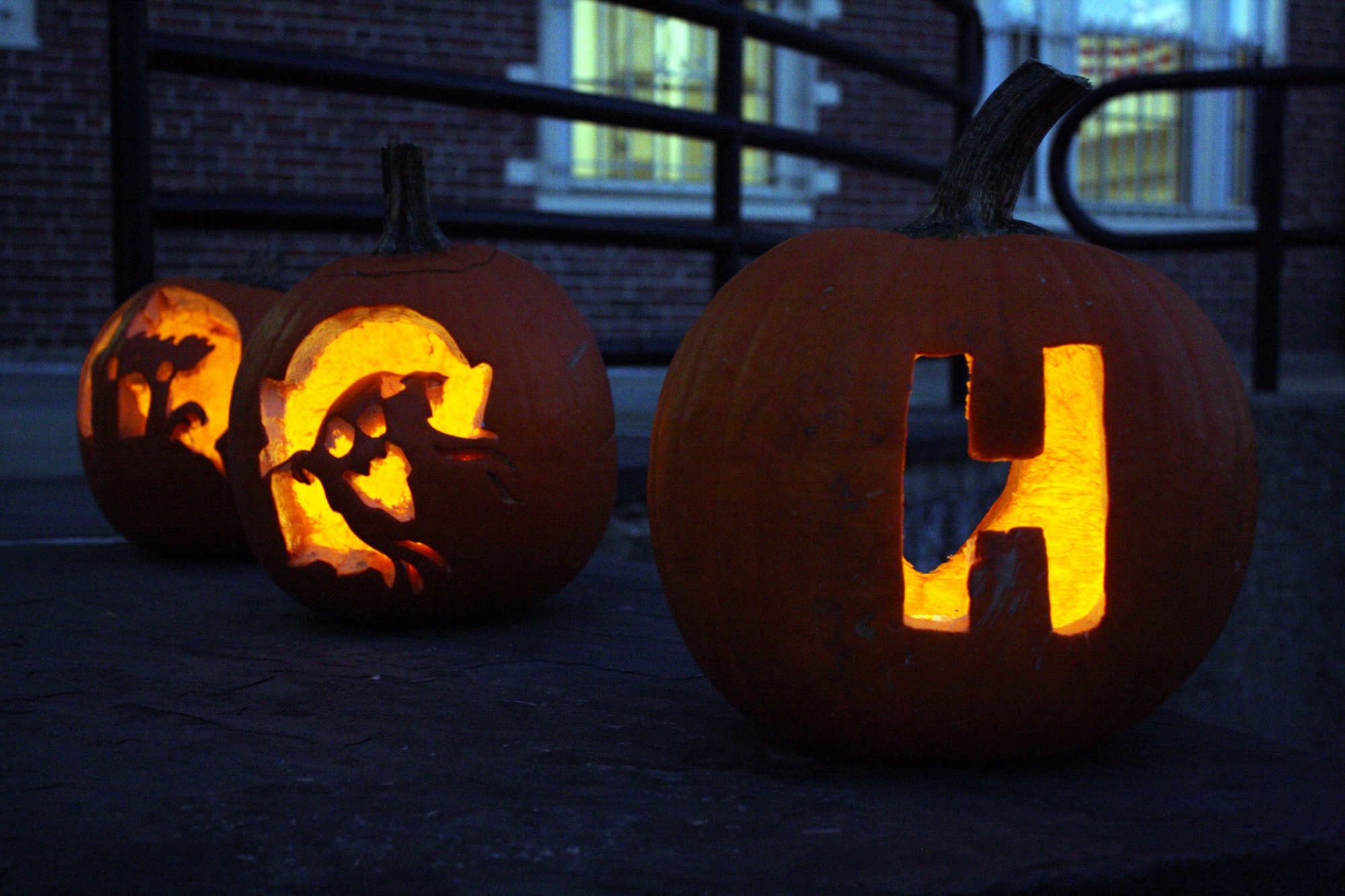 Student-carved pumpkins create a festive and spooky atmosphere on Friday evening.