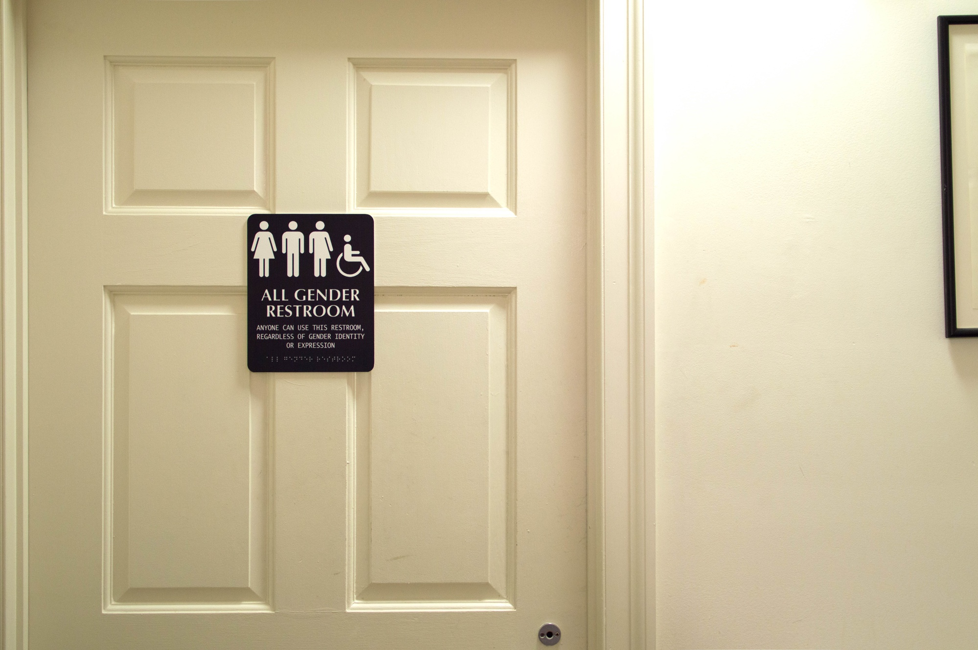 "An Adams House bathroom features an ""All Gender Restroom"" sign."
