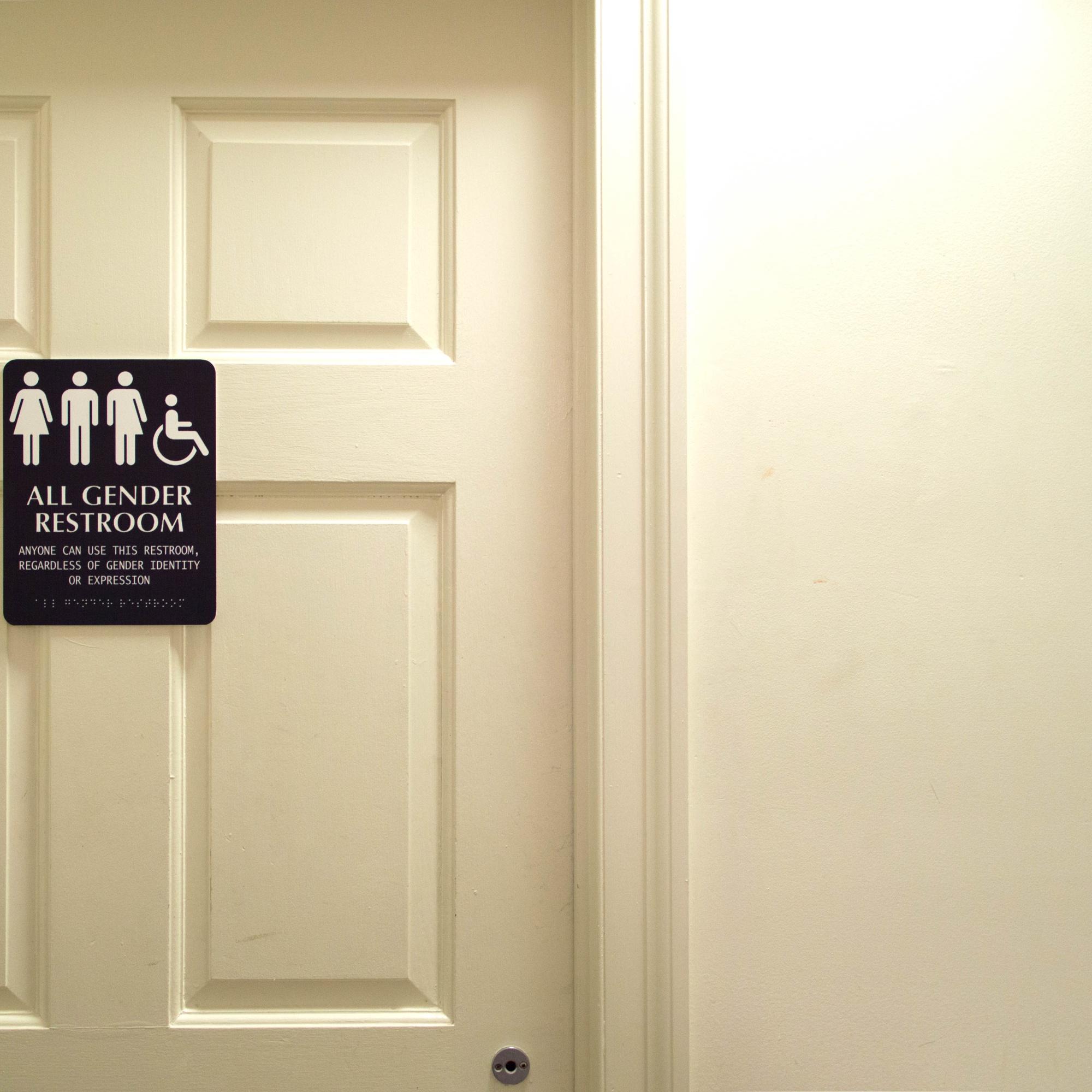 "An Adams House bathroom features an ""All Gender Restroom"" sign."