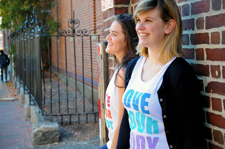 "Karen M. Maldonado '18 and Cassandra Hastie '18, both ECHO peer counselors, wear ""Love Your Body"" bro tanks that ECHO sold last semester."
